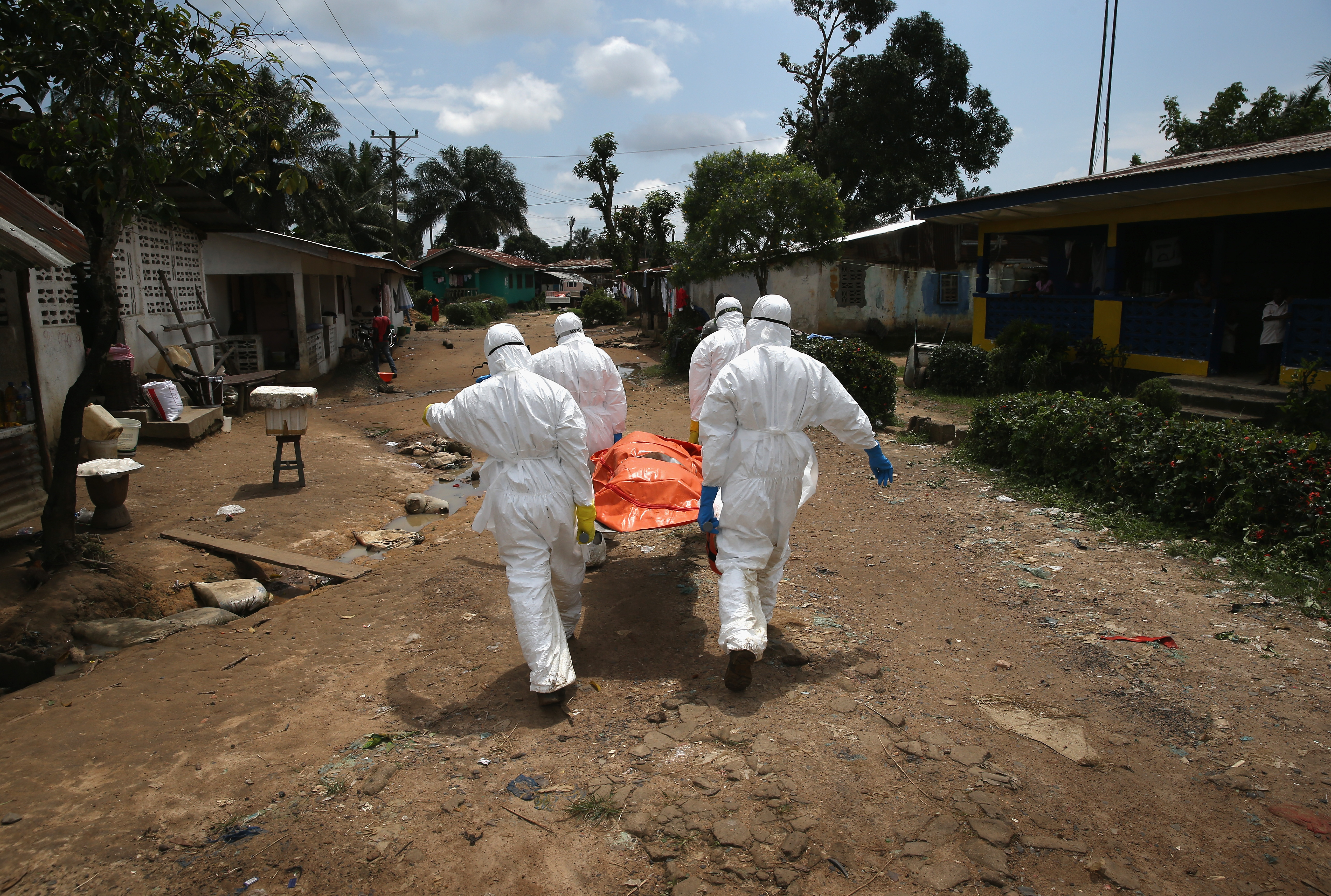 An Ebola burial team carries the body of a woman through the New Kru Town suburb on Oct. 10, 2014 of Monrovia, Liberia.