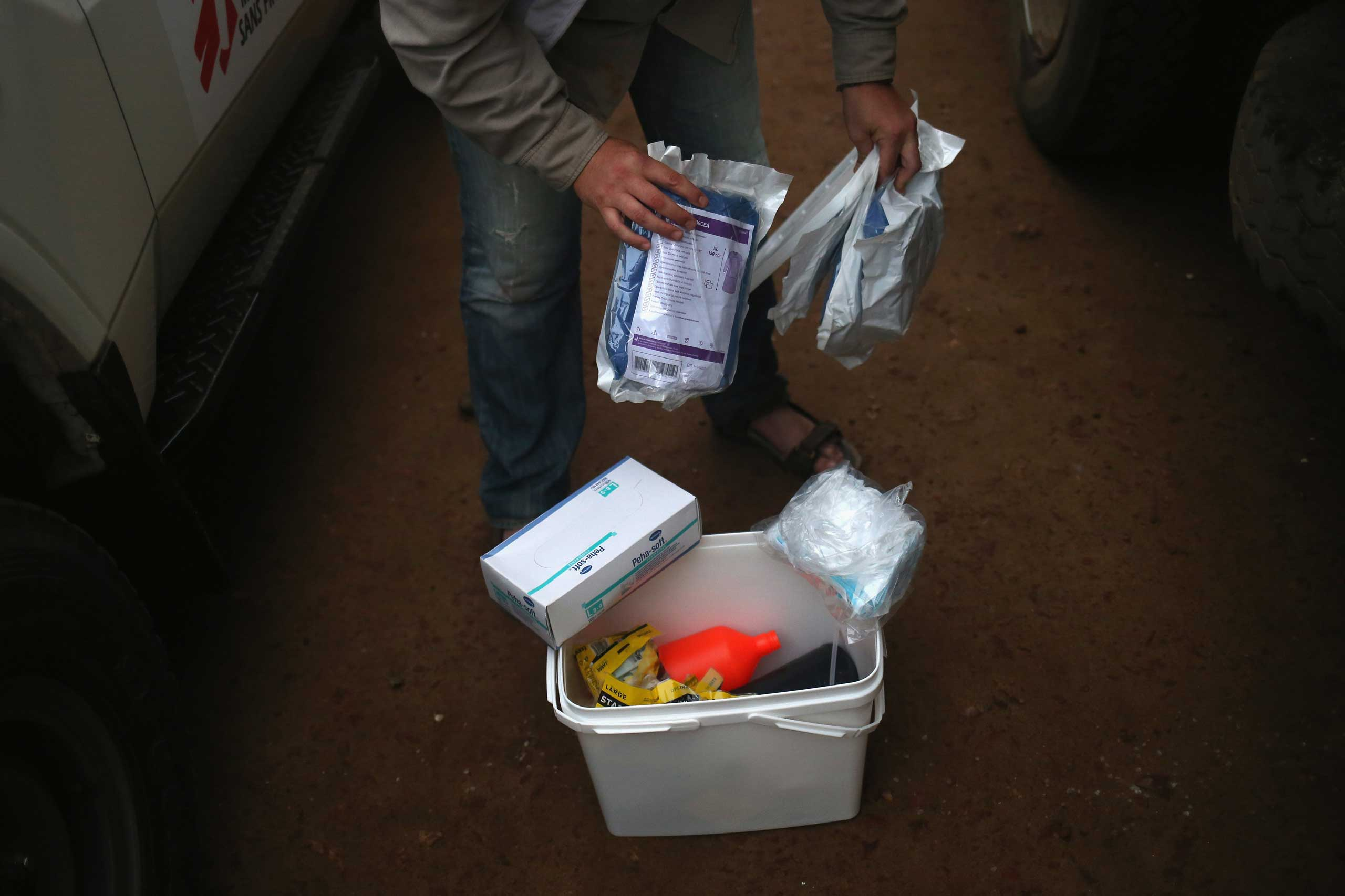 A Doctors Without Borders, worker displays a family and home disinfection kit which MSF distributed on Oct. 4, 2014 in New Kru Town, Liberia.