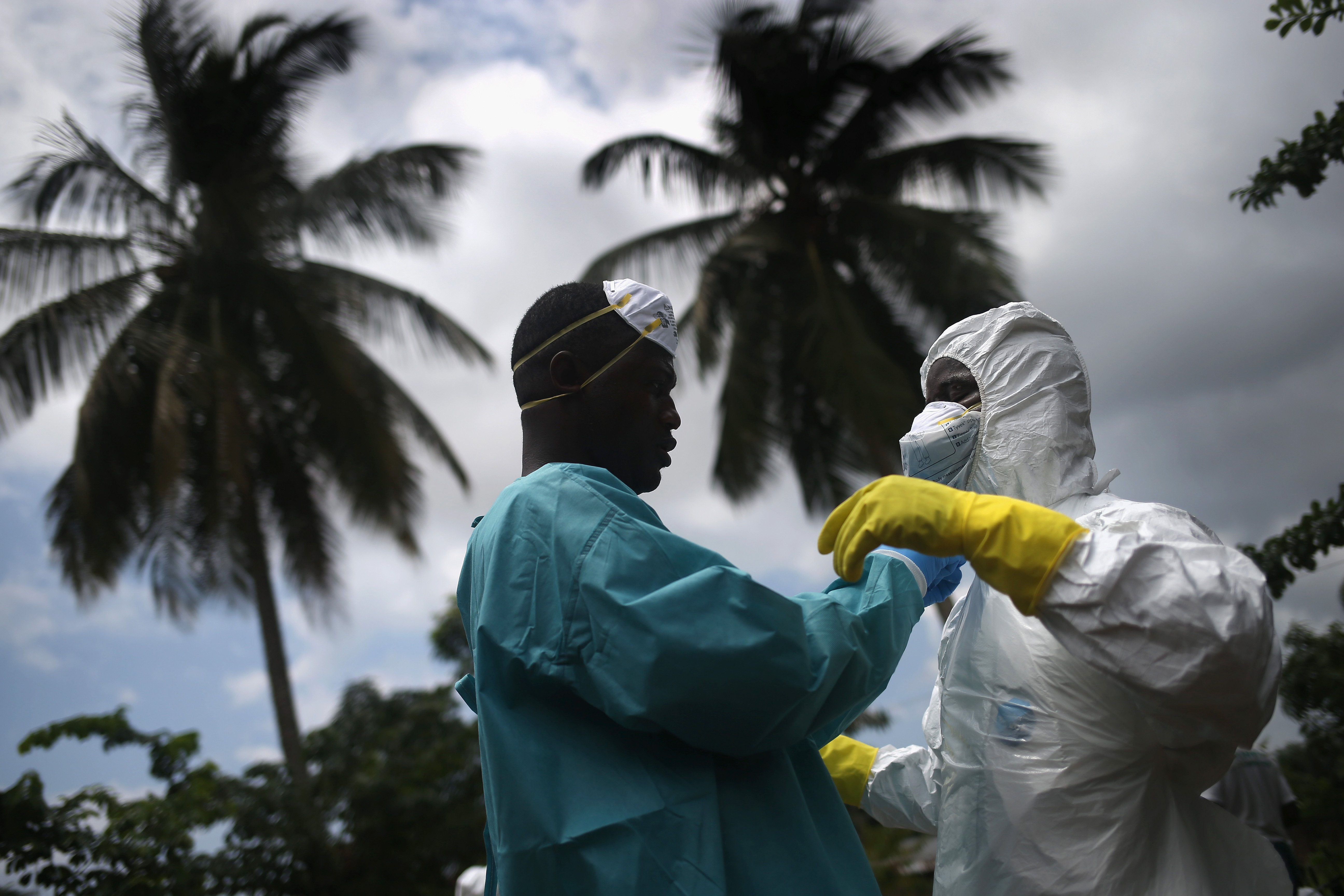 An Ebola burial team dresses in protective clothing before collecting the body of a woman from her home in the New Kru Town suburb of Monrovia, Liberia on Oct. 10, 2014
