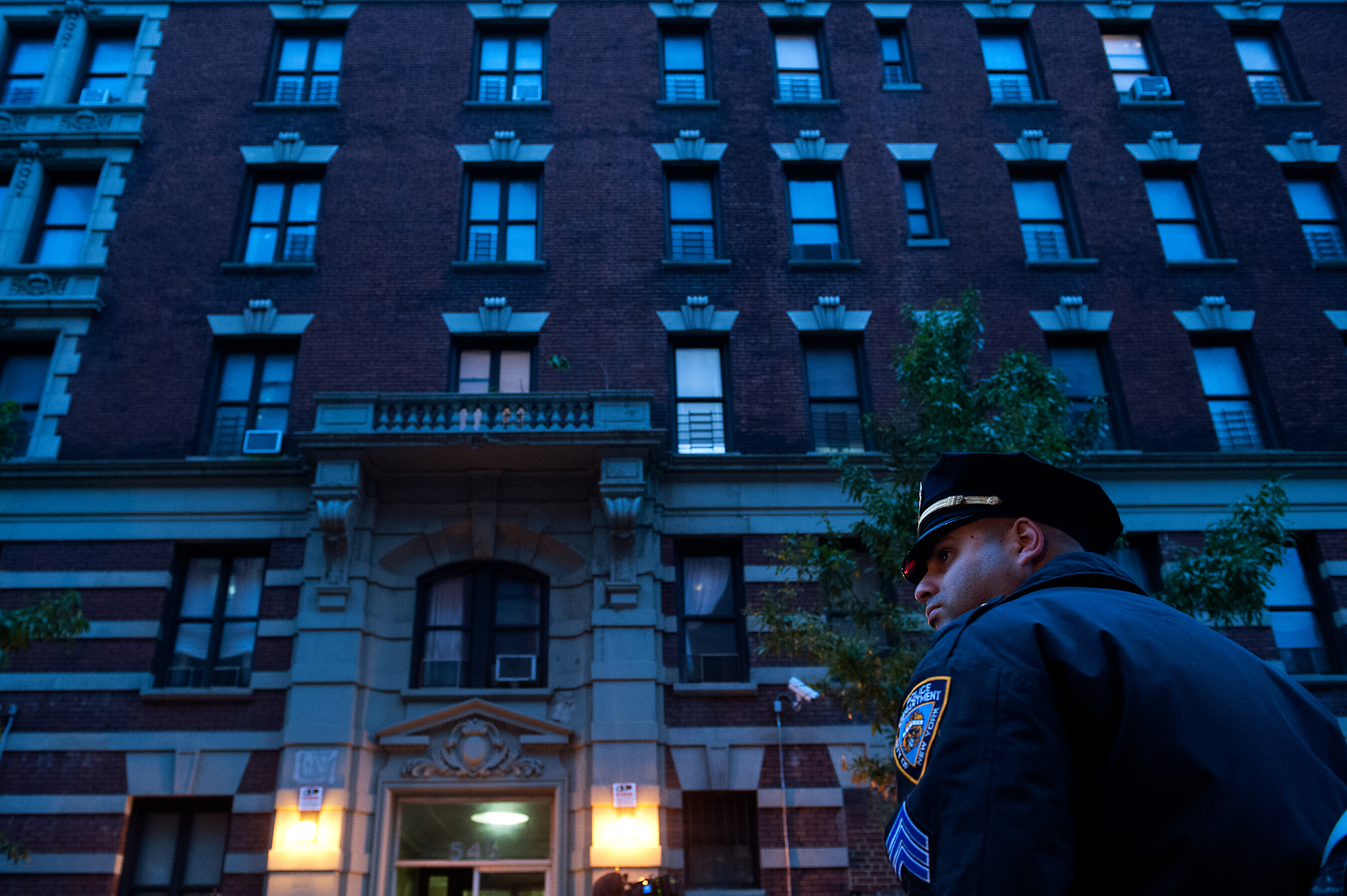 Police officers stand outside 546 W. 147th street, the apartment building of Dr. Craig Spencer on Oct. 23, 2014 in New York City.