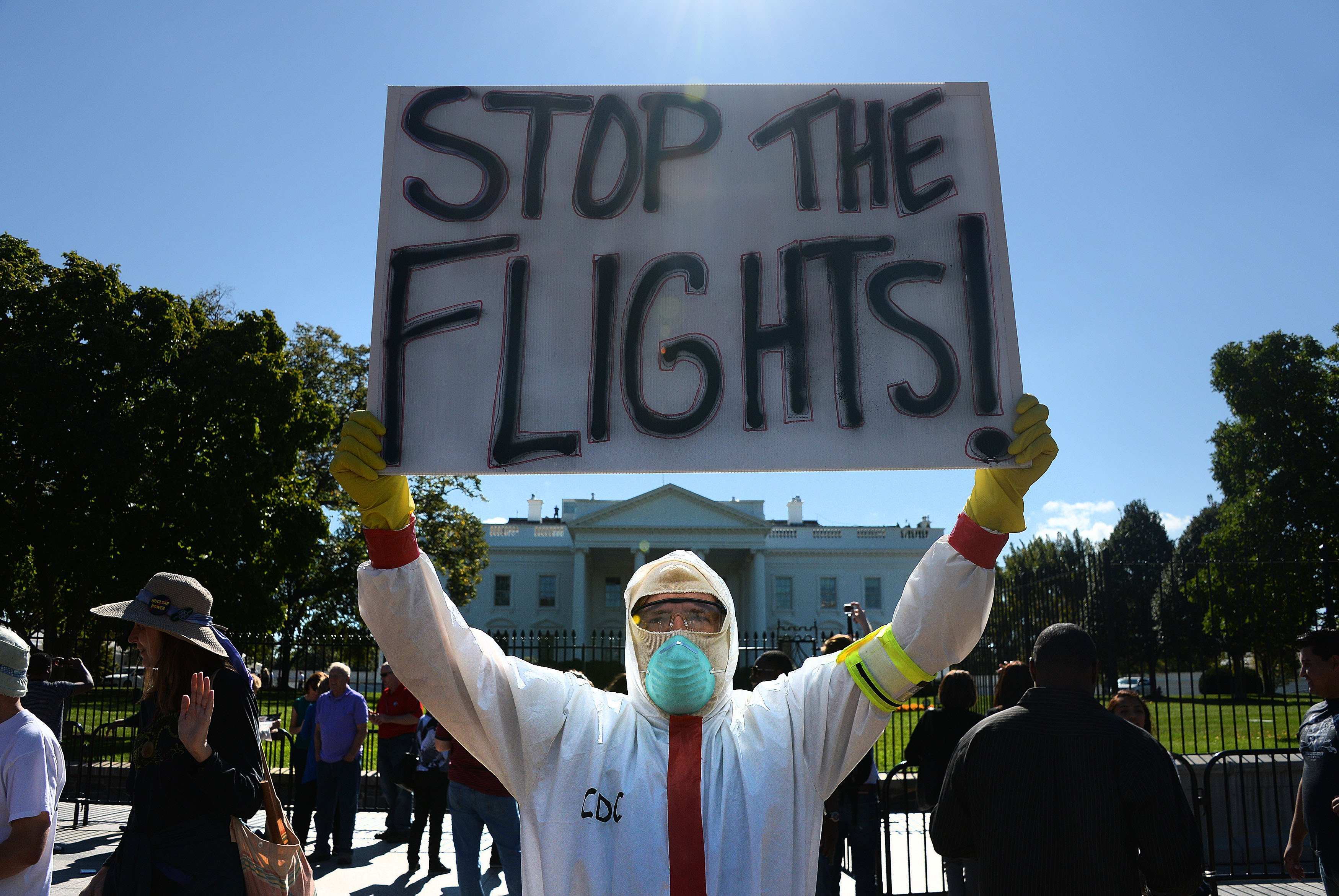 A protester stands outside the White House asking President Barack Obama to ban flights in effort to stop Ebola on Oct. 17, 2014 in Washington, DC.