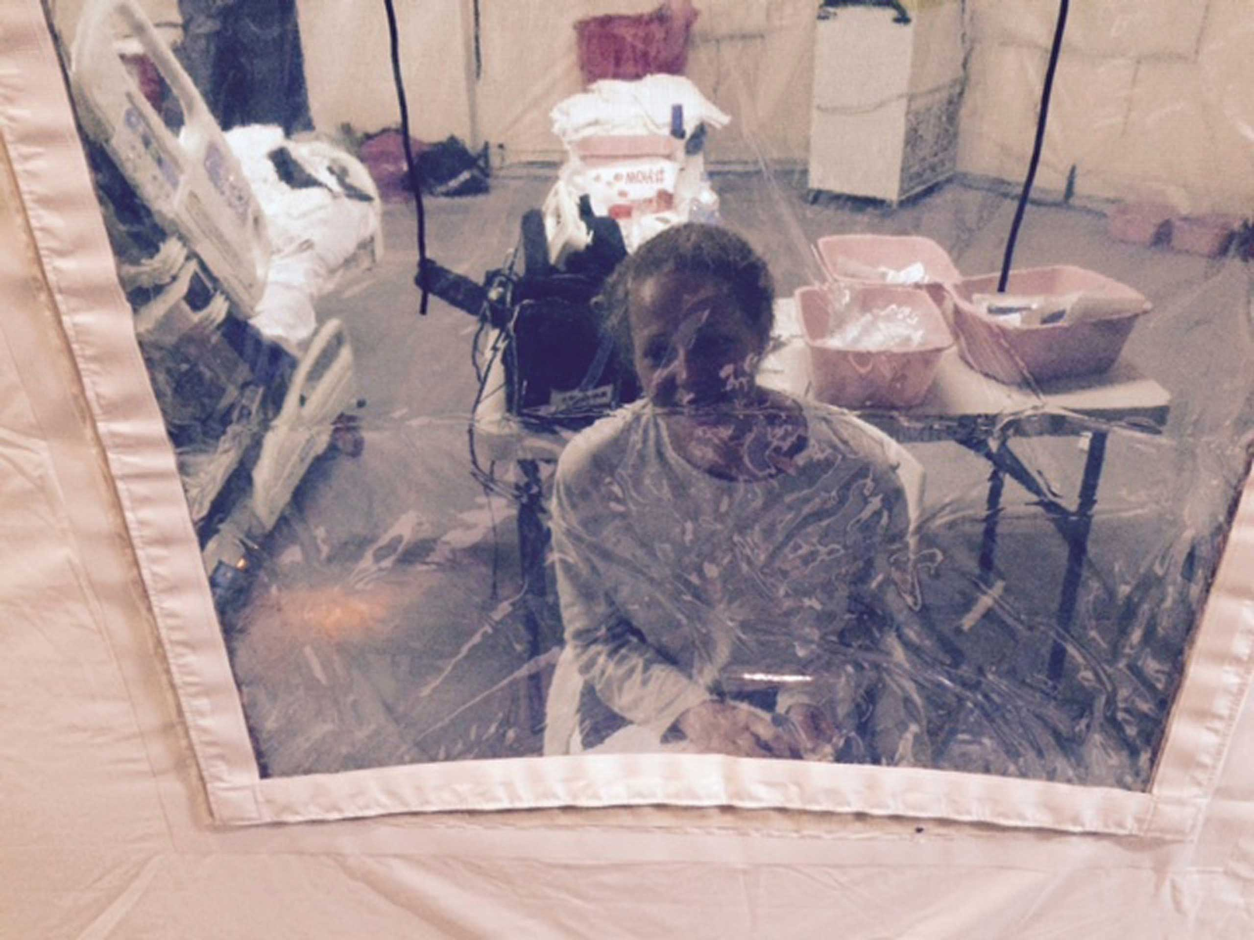 Kaci Hickox, a nurse who arrived in New Jersey on October 24 after treating Ebola patients in West Africa, seen in a hospital quarantine tent in Newark, New Jersey, Oct. 26, 2014.