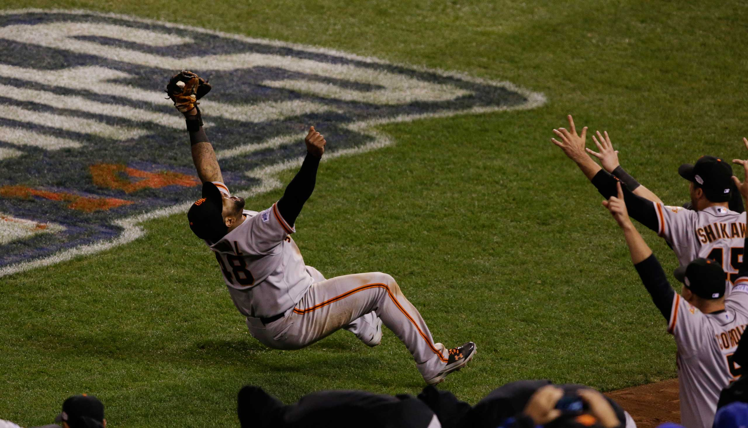 Oct. 29, 2014. San Francisco Giants Pablo Sandoval catches the last out a pop fly by Kansas City Royals Salvador Perez during the ninth inning of Game 7 of baseball's World Series Wednesday, in Kansas City, Mo. The Giants won 3-2 to win the series.