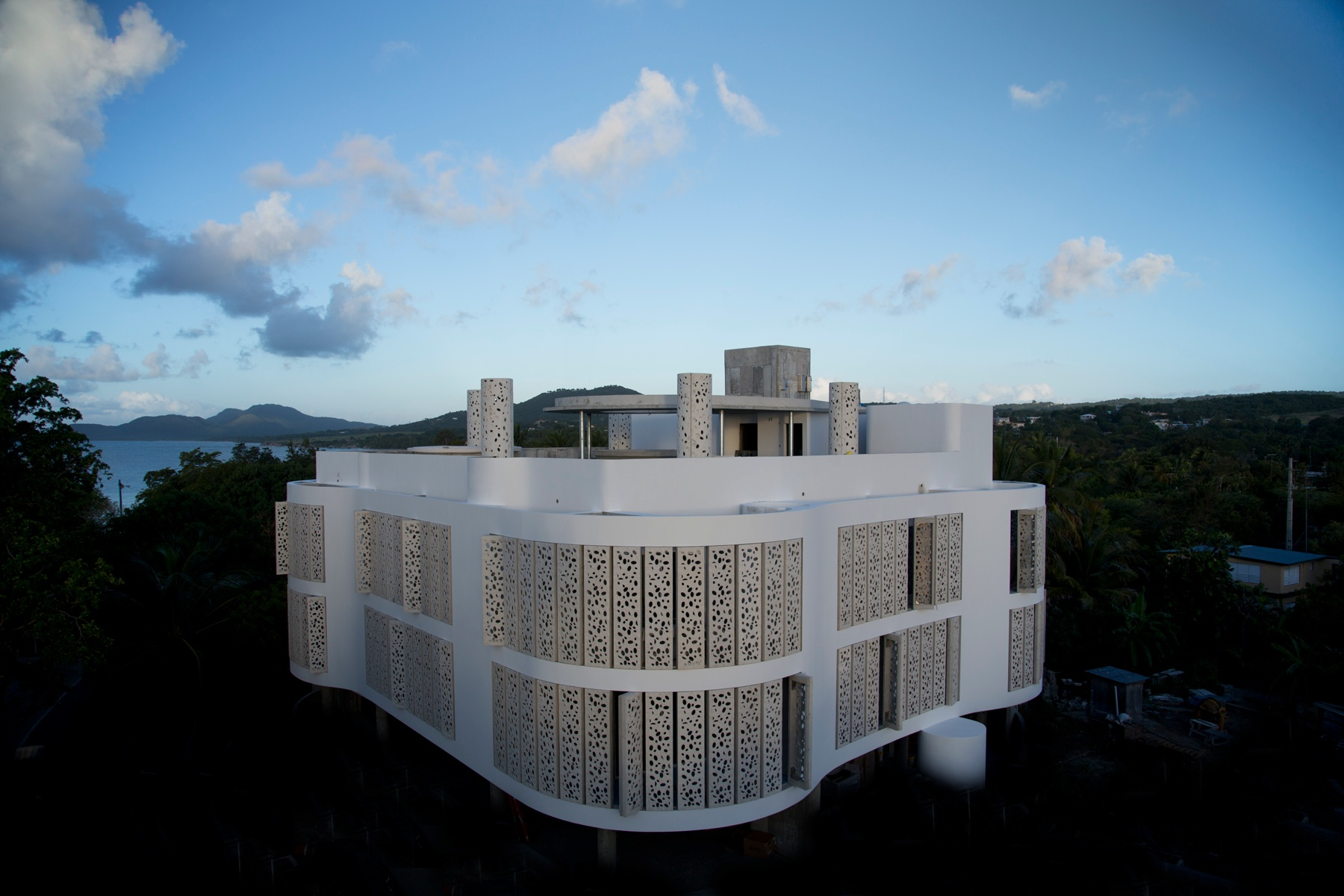 El Blok, Vieques, Puerto Rico Located on the compact 135 sq km Puerto Rican island of Vieques, El Blok is an intimate 22-room eco-hotel designed by local firm Fuster + Partners. They have not only harnessed thermal and solar power to generate electricity and heat, but also made clever use of local materials to create coral-inspired perforated panels that allow light and air to filter naturally through the building. Inside, most of the furniture is made locally, such as the almond tree bar and the reclaimed mahogany retro chairs, while a wild collection of coconut fibre sculptures by San Juan-based artists Jamie and Javier Suarez hold court. The Puerto Rican theme continues through to the hotel's restaurant, which refocuses seating by the bar to emulate the socialising often found in a town square. Helmed by chef José Enriques, El Blok serves up elevated renditions of traditional dishes to complete the experience.                                                              58 Calle Flamboyan, Esperanza, Vieques; Tel: 1.787 741 6020; elblok.com; Rates from $215