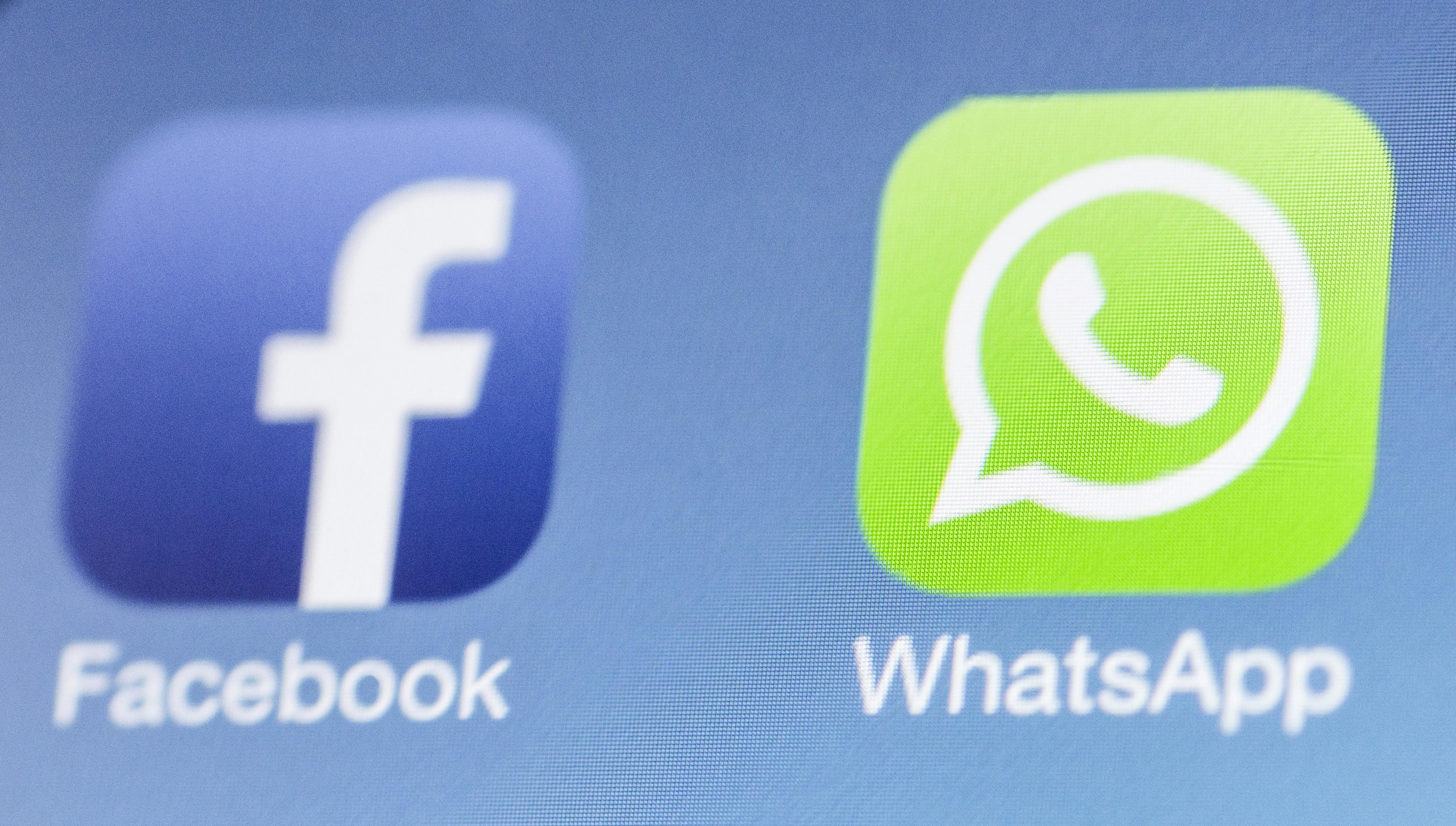 Facebook next to the WhatsApp logo on iPhone on February 25, 2014 in Berlin, Germany.
