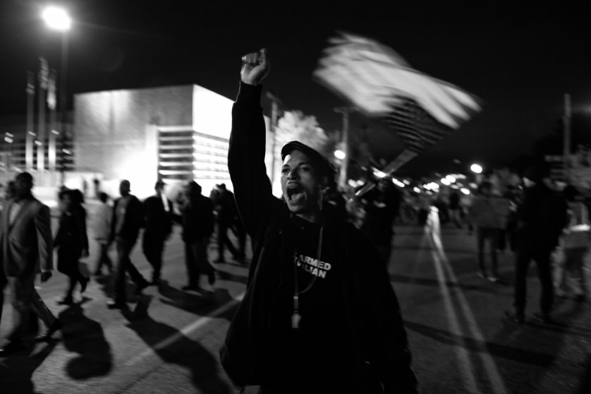 A protester raises his fist during a nightly march toward the Ferguson Police Dept. on Oct. 10, 2014.
