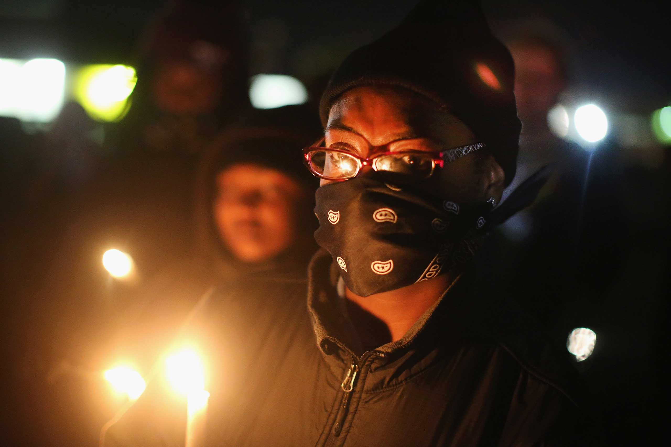 Demonstrators hold a candlelight vigil in memory of Michael Brown and other young minorities killed by gunfire, in Ferguson, Mo. on Oct. 10, 2014.