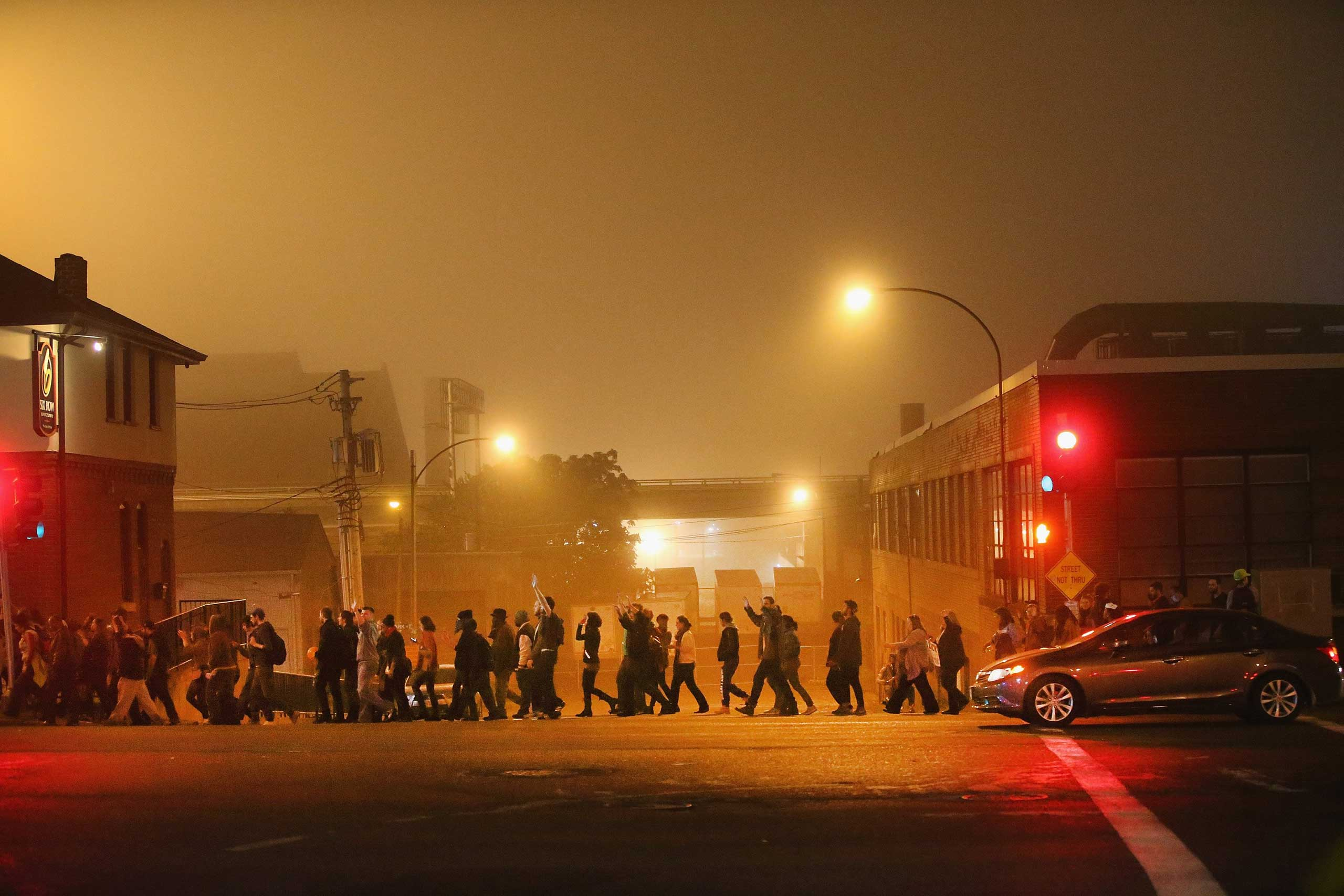 Demonstrators march through the streets  of St. Louis on Oct. 13, 2014.