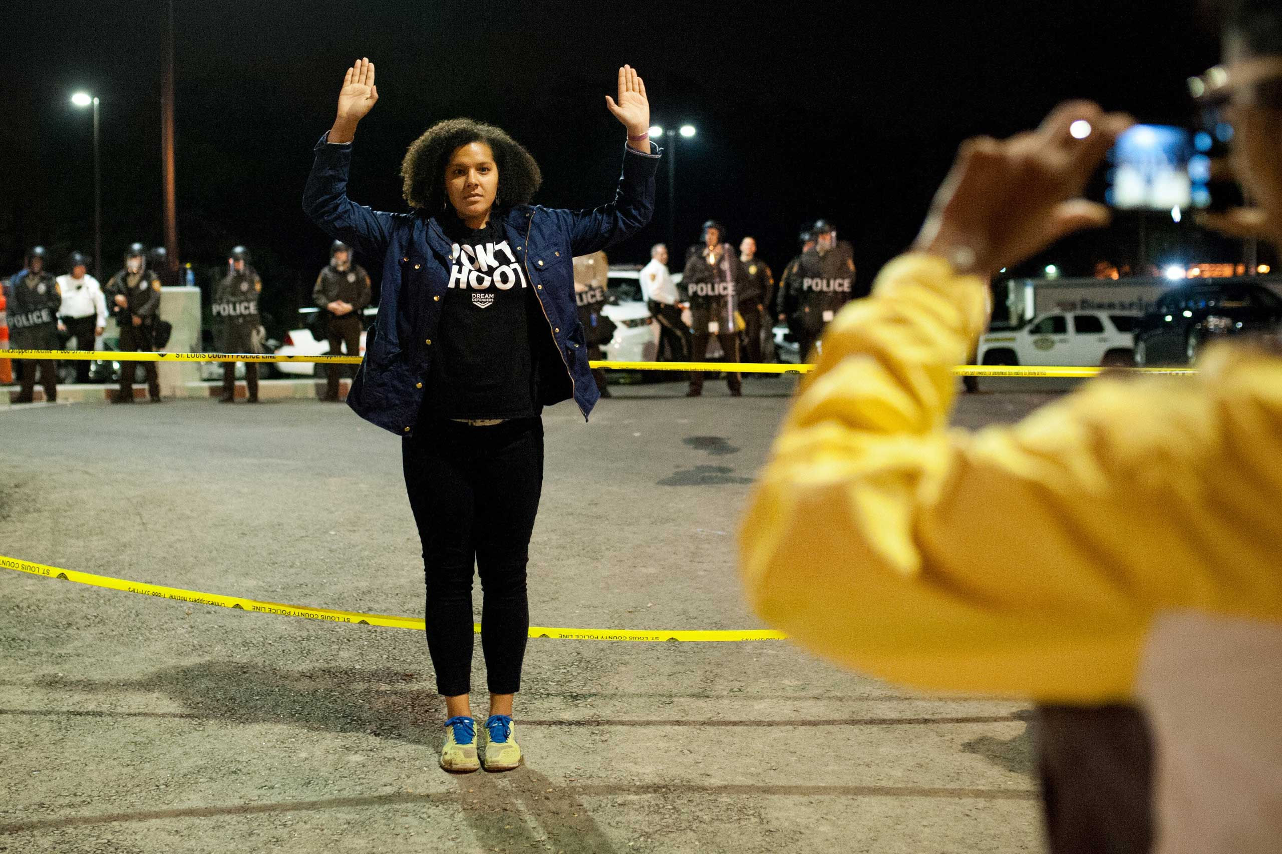 A protester poses for a photo after while protesting at the  Ferguson Police Department in Ferguson, Mo. on Oct. 12, 2014.