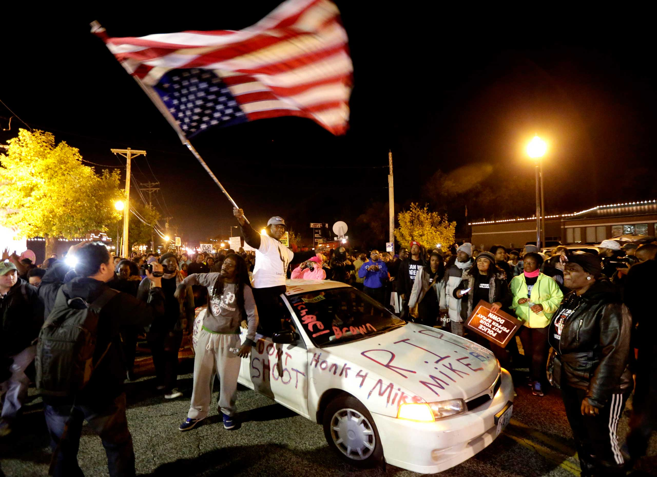 Protesters arrive at the Ferguson Police Department for a rally in Ferguson, Mo. on Oct. 11, 2014.