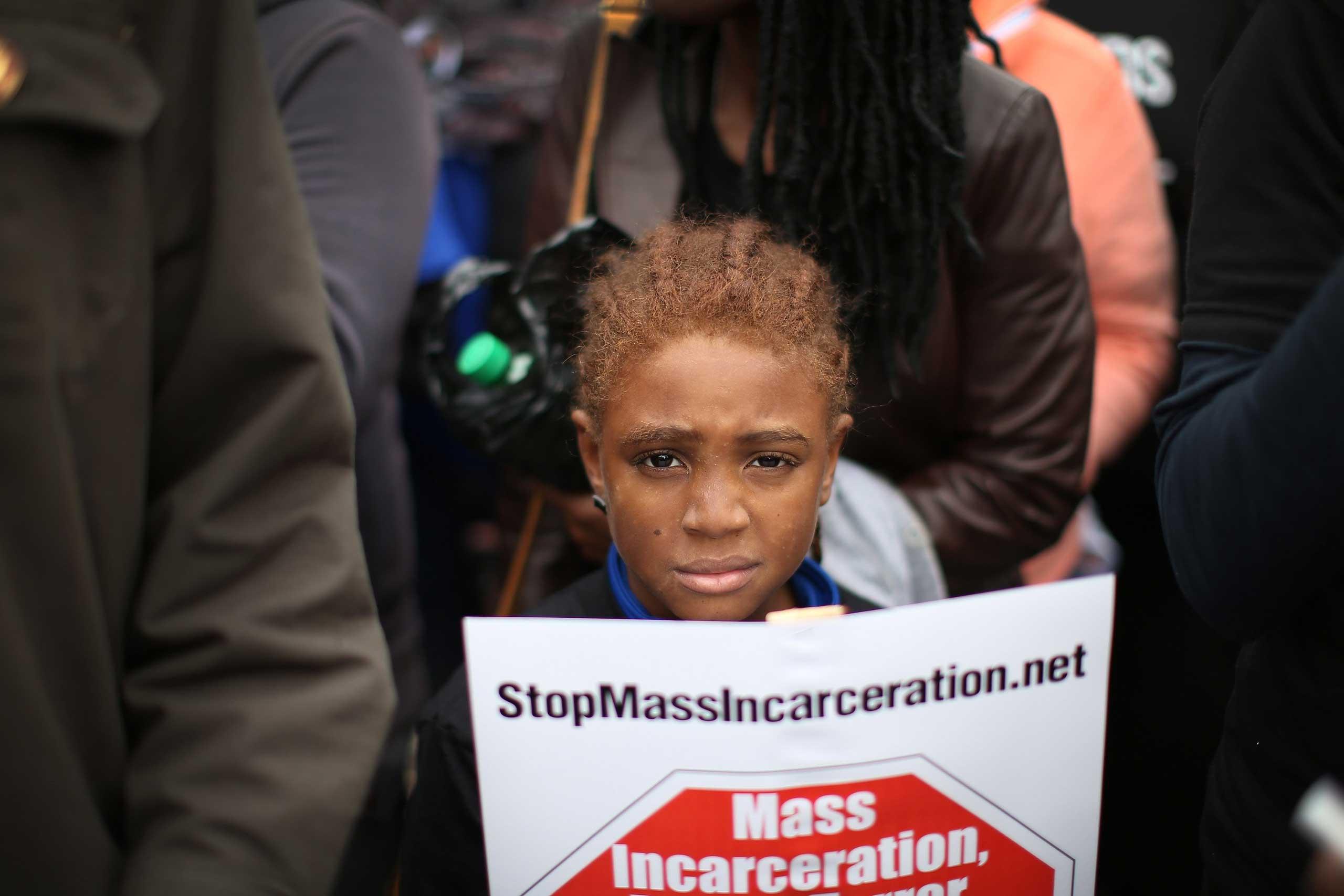 Nine-year-old Bill Jackson joins demonstrators in St. Louis on Oct. 11, 2014.