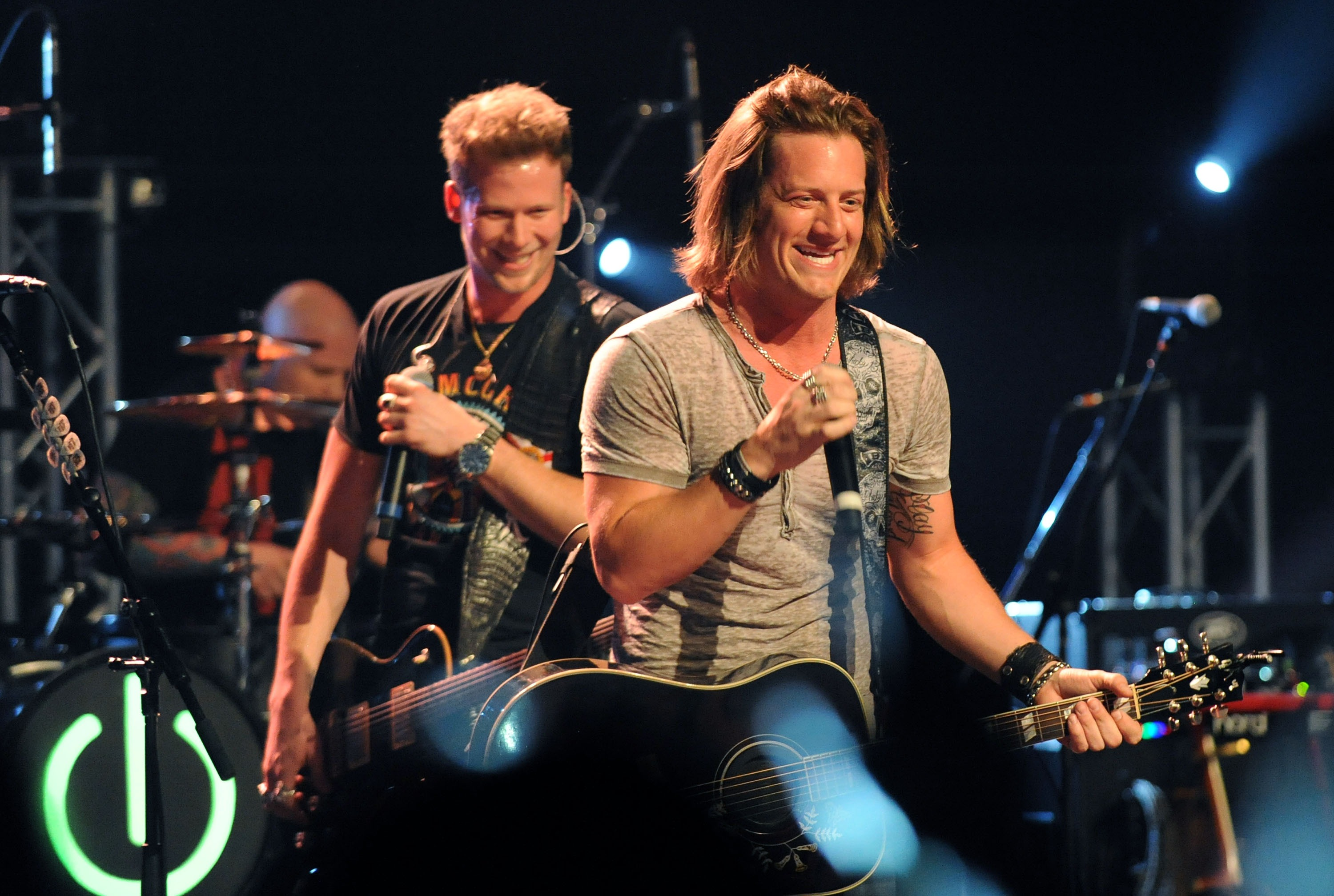 From left: Brian Kelley and Tyler Hubbard of Florida Georgia Line perform at the Georgia Theatre on March 20, 2013 in Athens, Ga.