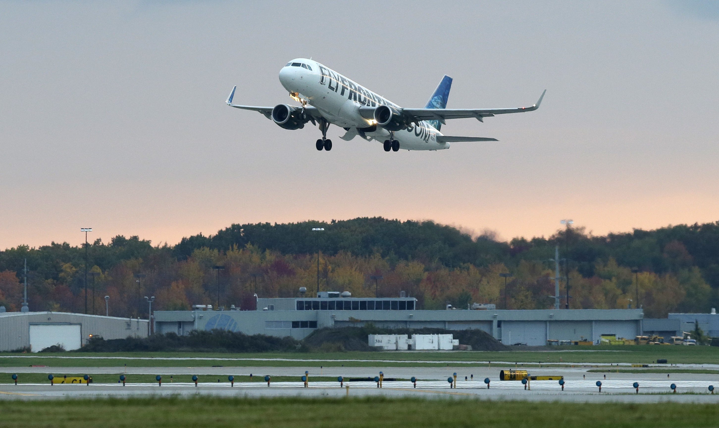 The Frontier Airlines plane that Amber Vinson flew from Cleveland to Dallas on Monday, flies out of Cleveland Hopkins International Airport Wednesday, Oct. 15, 2014, in Cleveland.