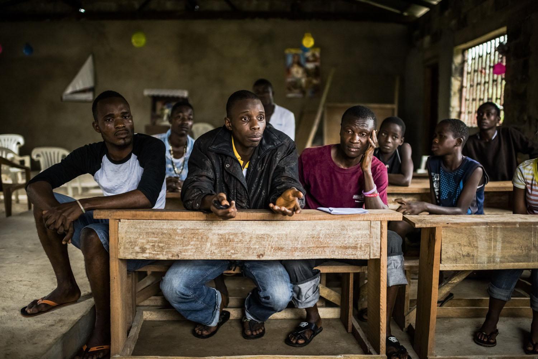 Residents discuss an Ebola awareness campaign in Monrovia, Liberia, Aug. 30, 2014.