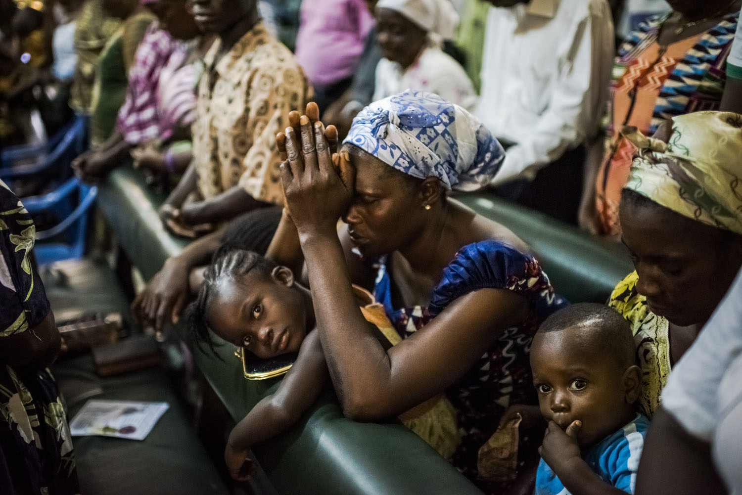 Residents of the West Point neighborhood attend church after a 10-day quarantine was lifted in Monrovia, Liberia, Aug. 31, 2014.