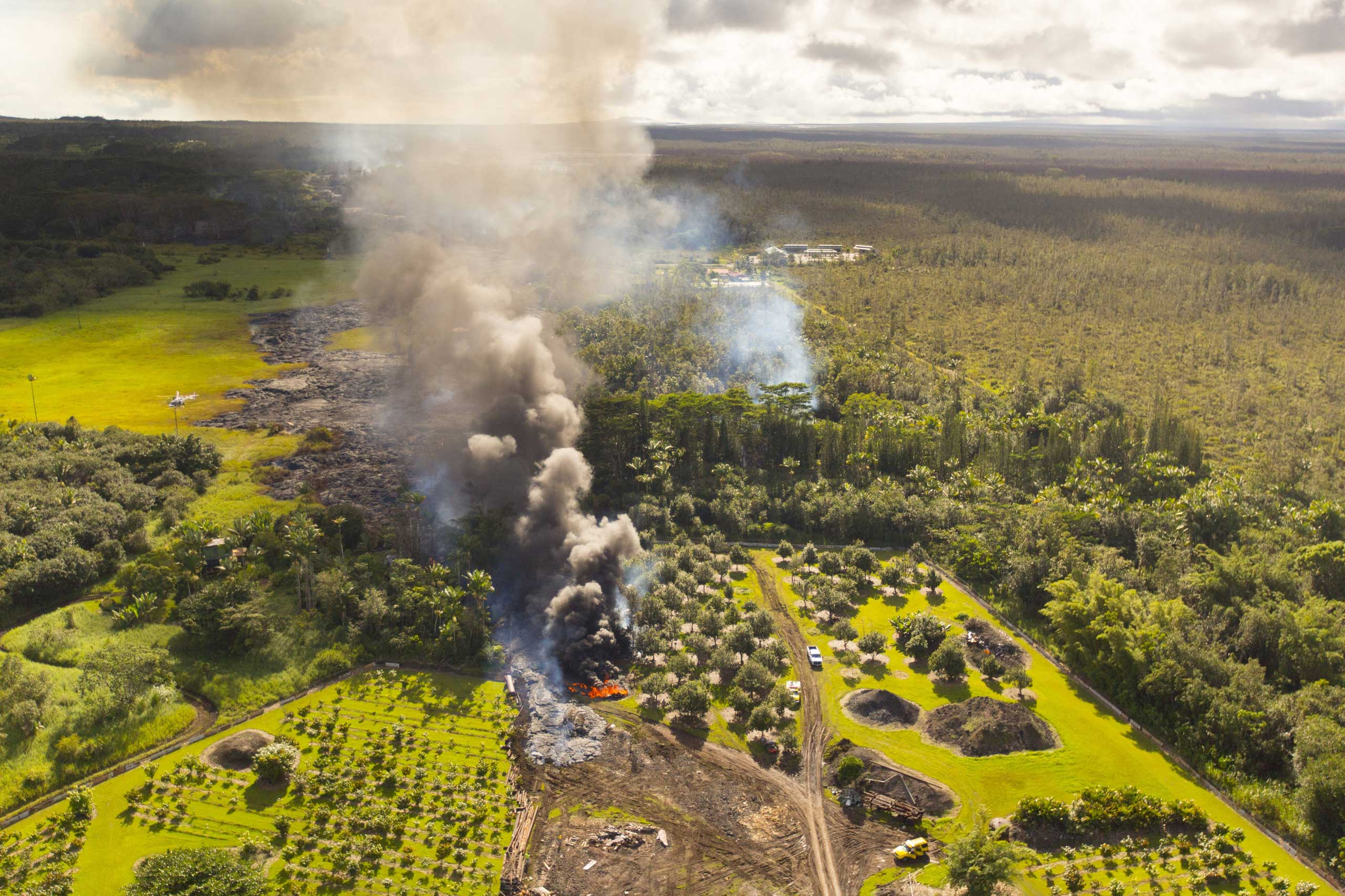 Lava flow from the Kilauea Volcano moves along the ground  in Pahoa, Hawaii on Oct. 28, 2014.