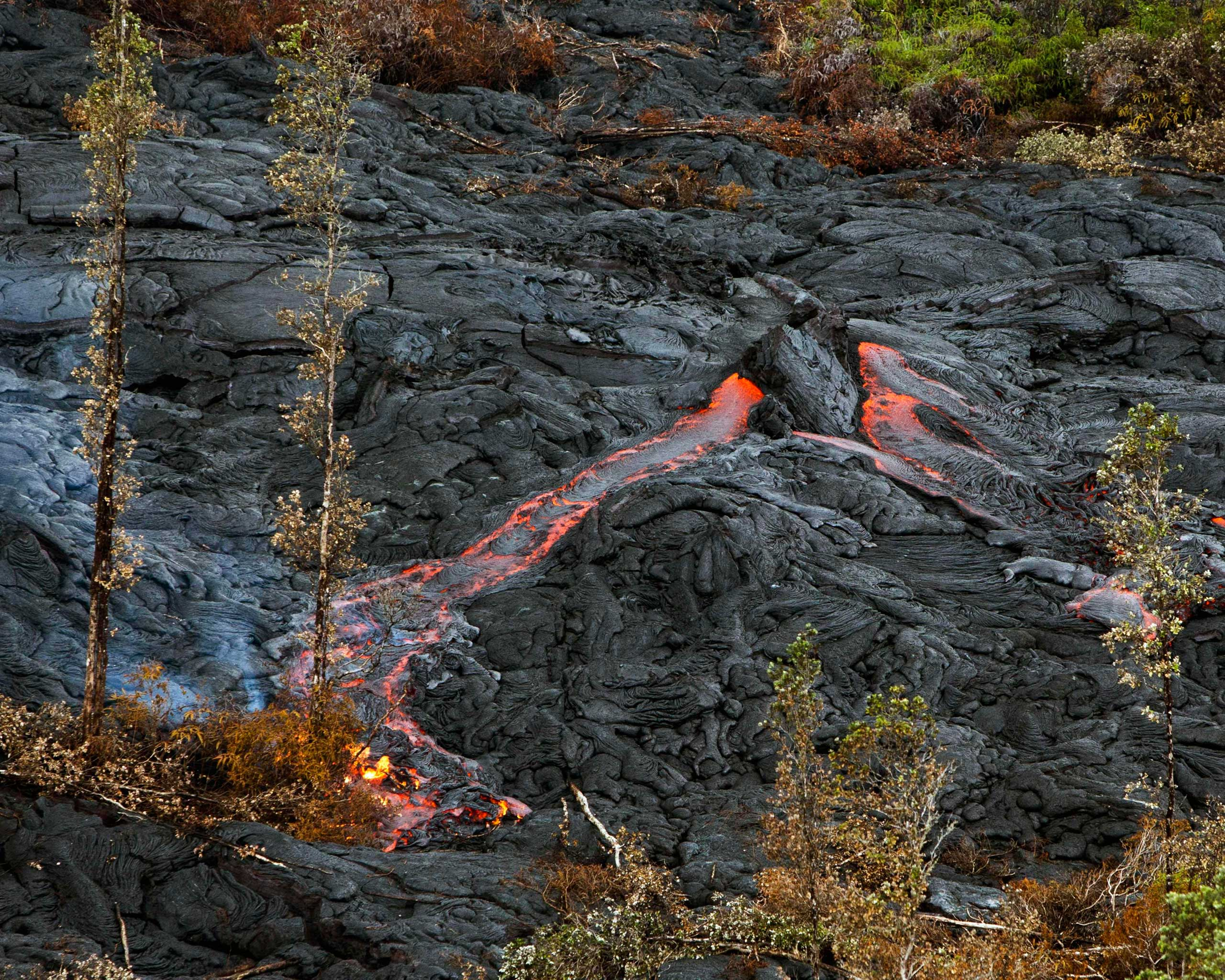 Lava spouts from a hot spot as the lava flow from Kilauea Volcano inches closer to the village of Pahoa, Hawaii on Oct. 29, 2014.