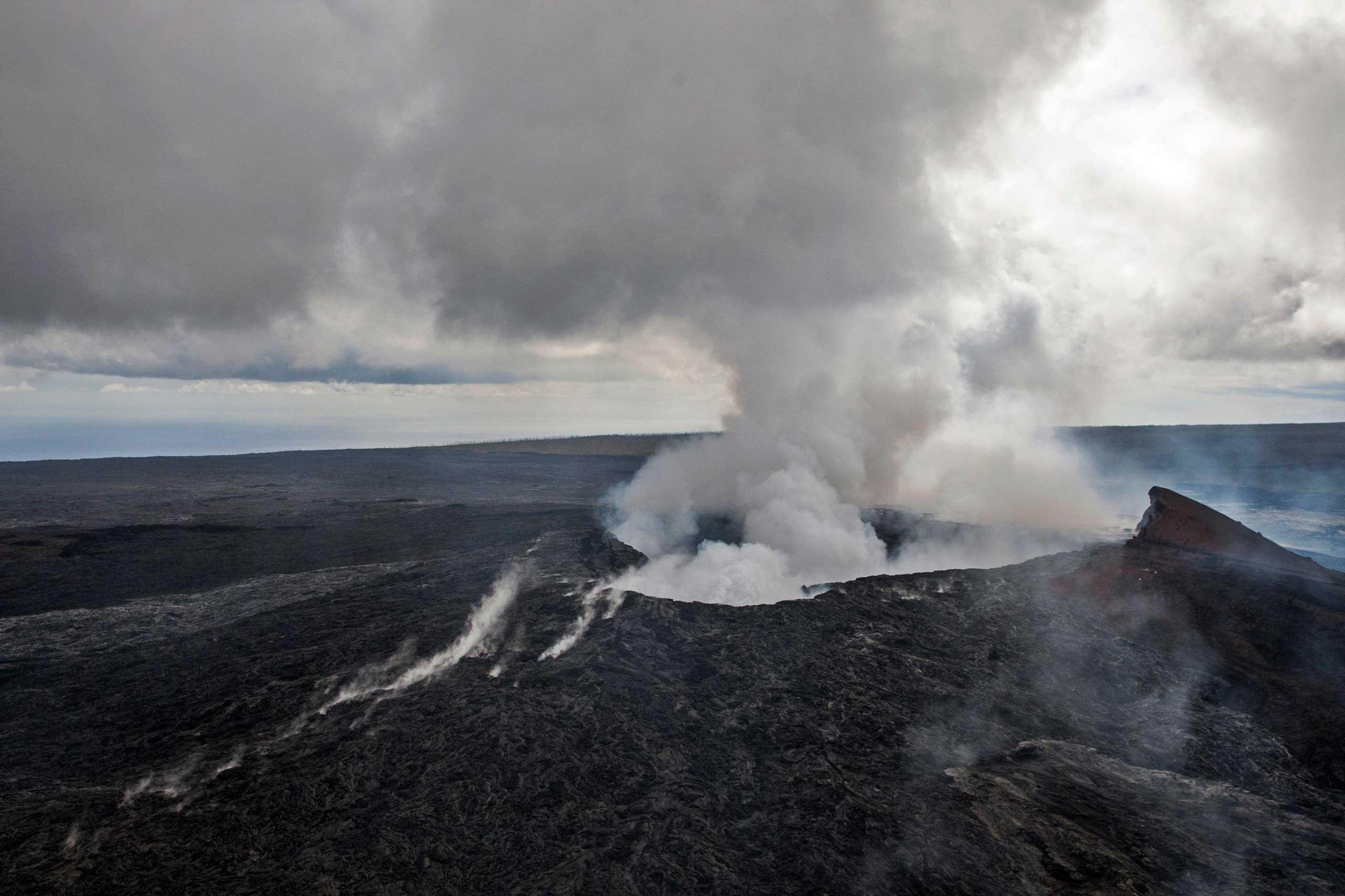Smoke rises from the  Pu'u O'o vent on the Kilauea Volcano on the Big Island of Hawaii on Oct. 29, 2014.