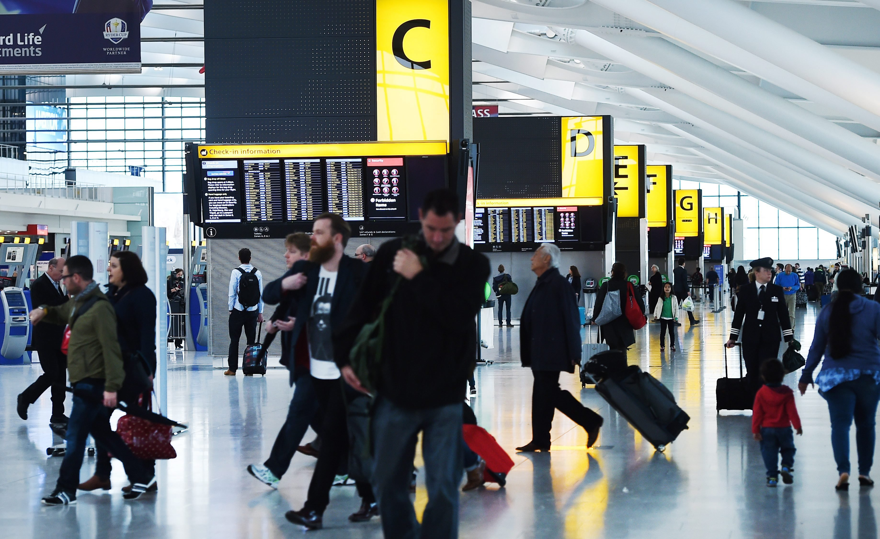 Passengers walk at Heathrow Airport in London on Oct. 14, 2014.