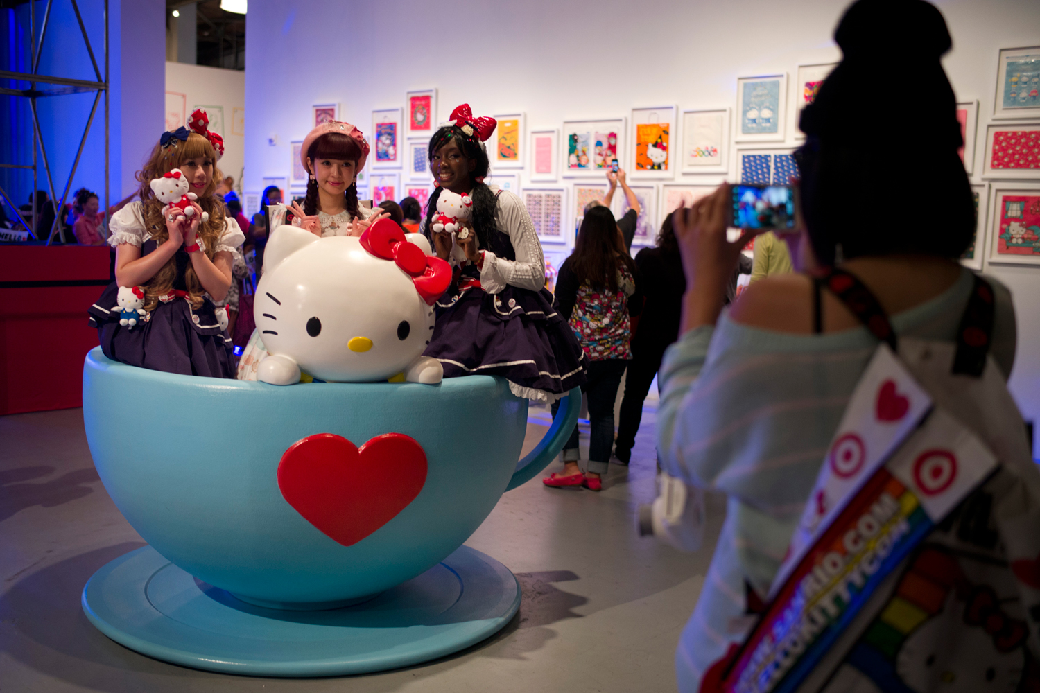 Hello Kitty fans pose for photos in a giant tea cup at the Hello Kitty Con, the first-ever Hello Kitty fan convention, held at the Geffen Contemporary at MOCA, Oct. 30, 2014, in Los Angeles