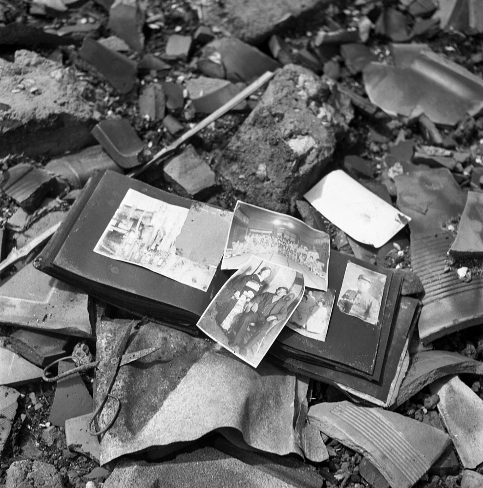 <b>Not published in LIFE.</b> A photo album, pieces of pottery, a pair of scissors - shards of life strewn on the ground in Nagasaki, 1945.