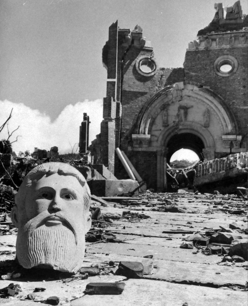 Bust in front of destroyed cathedral two miles from the atomic bomb detonation site, Nagasaki, Japan, 1945.