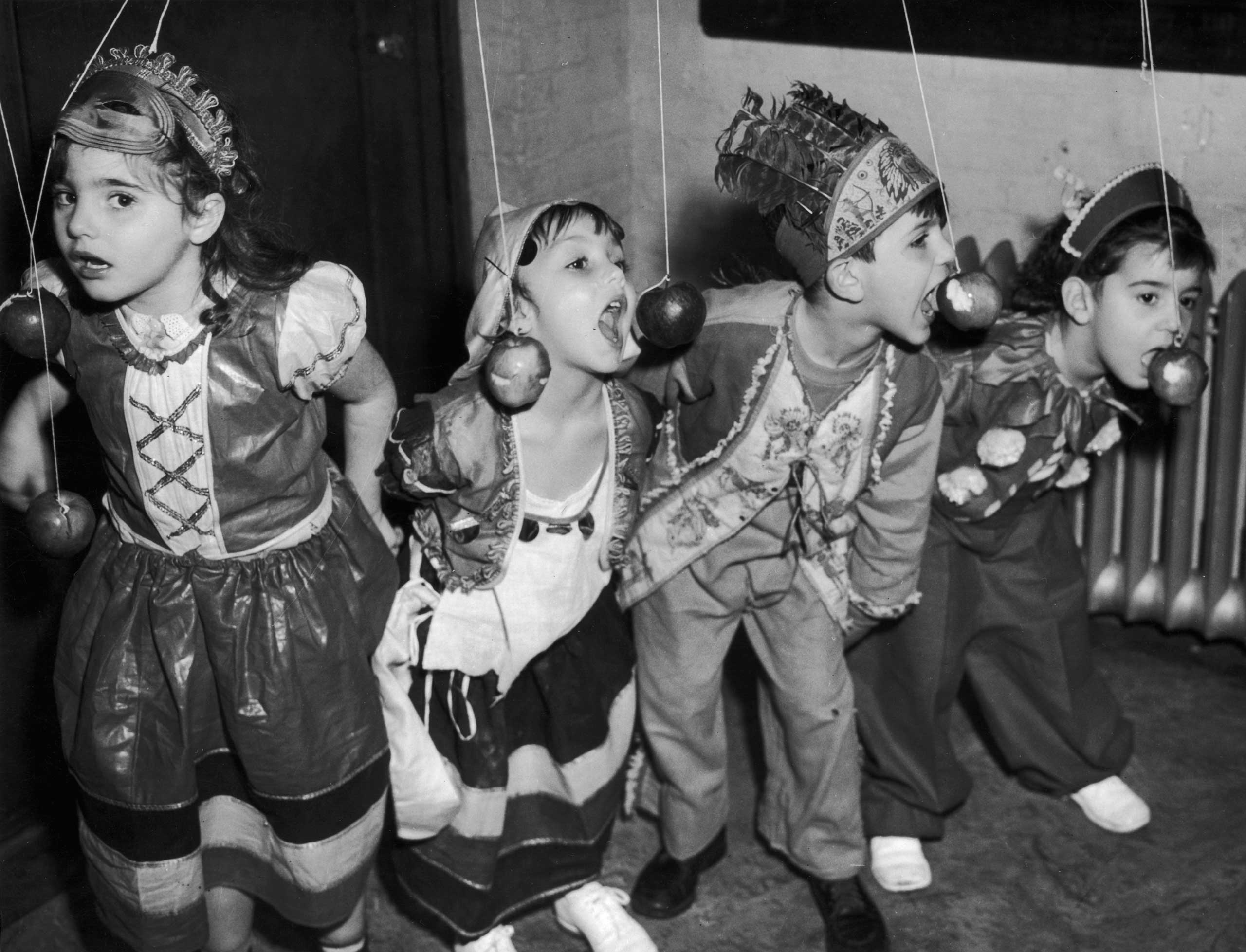 Children celebrate at a Halloween party in New York City circa 1940.