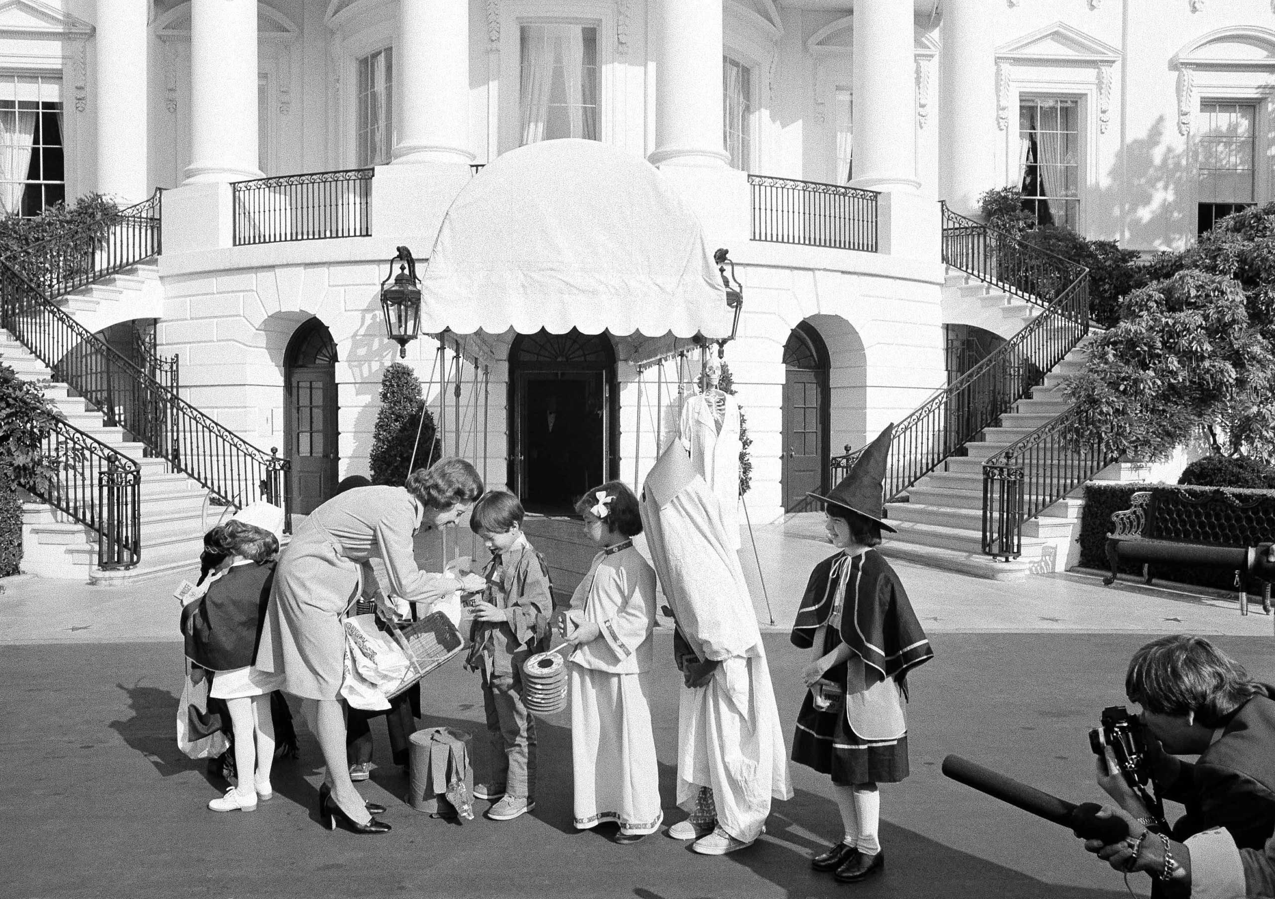 First lady Betty Ford greets costumed school children on the White House South Lawn on Oct. 31, 1974 in Washington D.C. during a Halloween benefit for the United Nations International Children's Emergency Fund.