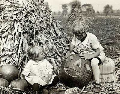 07 Oct 1930 --- Children carve their own pumpkins for Halloween on Oct 7, 1930.