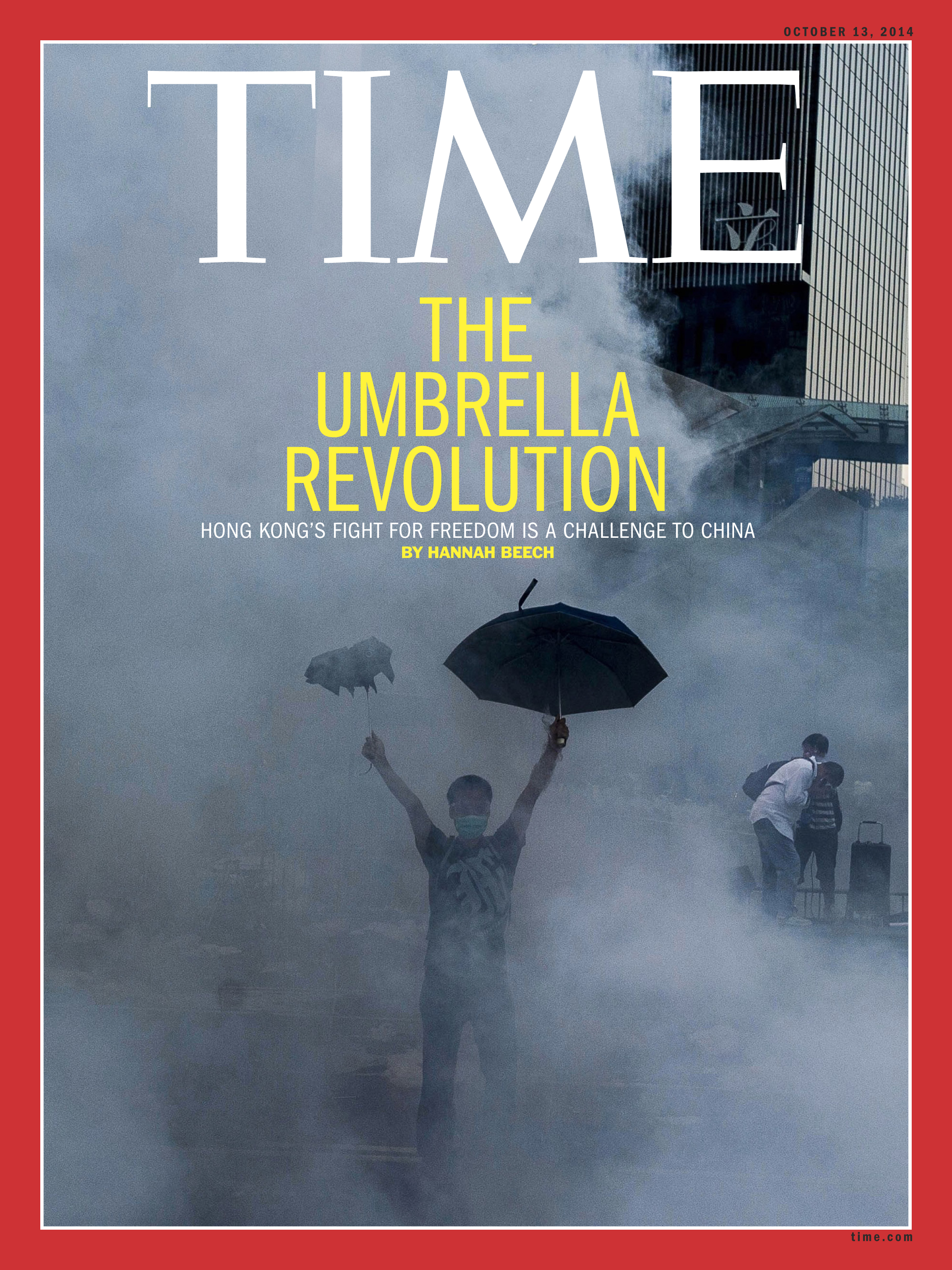 A protester stands defiantly while media tycoon Jimmy Lai, right, in a white shirt, receives assistance after being tear gassed in this image used on the Oct. 13, 2014, cover of TIME's international edition