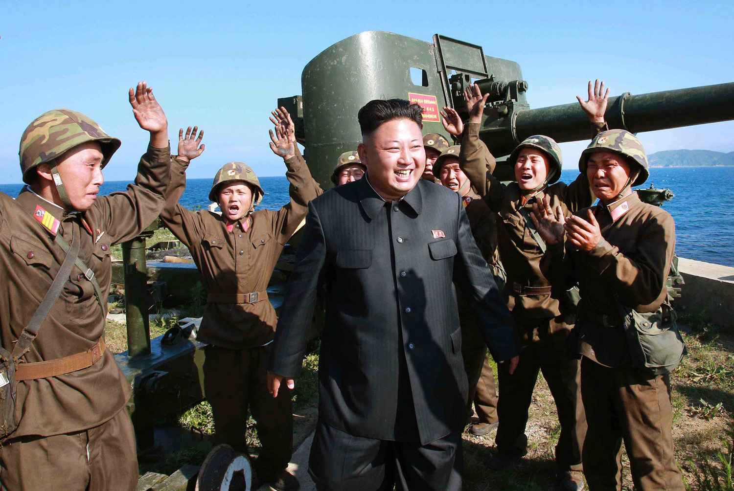 This undated picture released from North Korea's official Korean Central News Agency (KCNA) on July 7, 2014 shows North Korean leader Kim Jong-Un (C) being celebrated by soldiers as he inspects the defense detachment on Ung Islet, defending an outpost in the East Sea of Korea.
