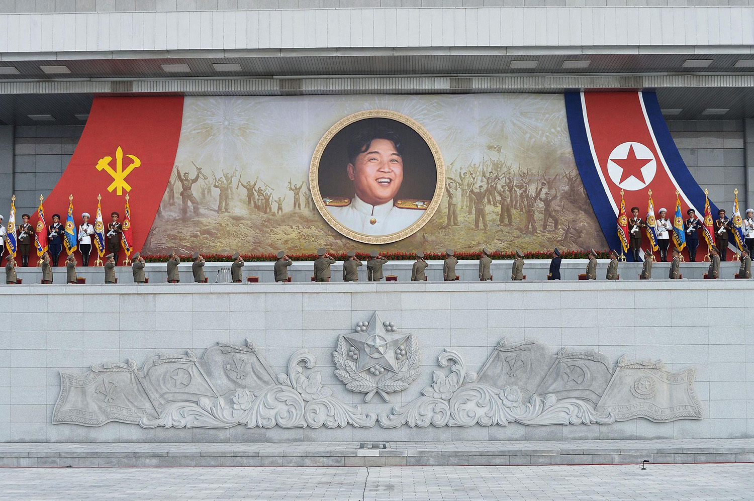 This photo taken on July 27, 2014 and released on July 28, 2014 by North Korea's official Korean Central News Agency (KCNA) shows service personnel of North Korean Army salute to a portrait of North Korean leader Kim Jong-Un clad in marshal unform at the plaza of the Kumsusan Palace of the Sun in Pyongyang, the 61st anniversary of the victory of the Fatherland Liberation War.