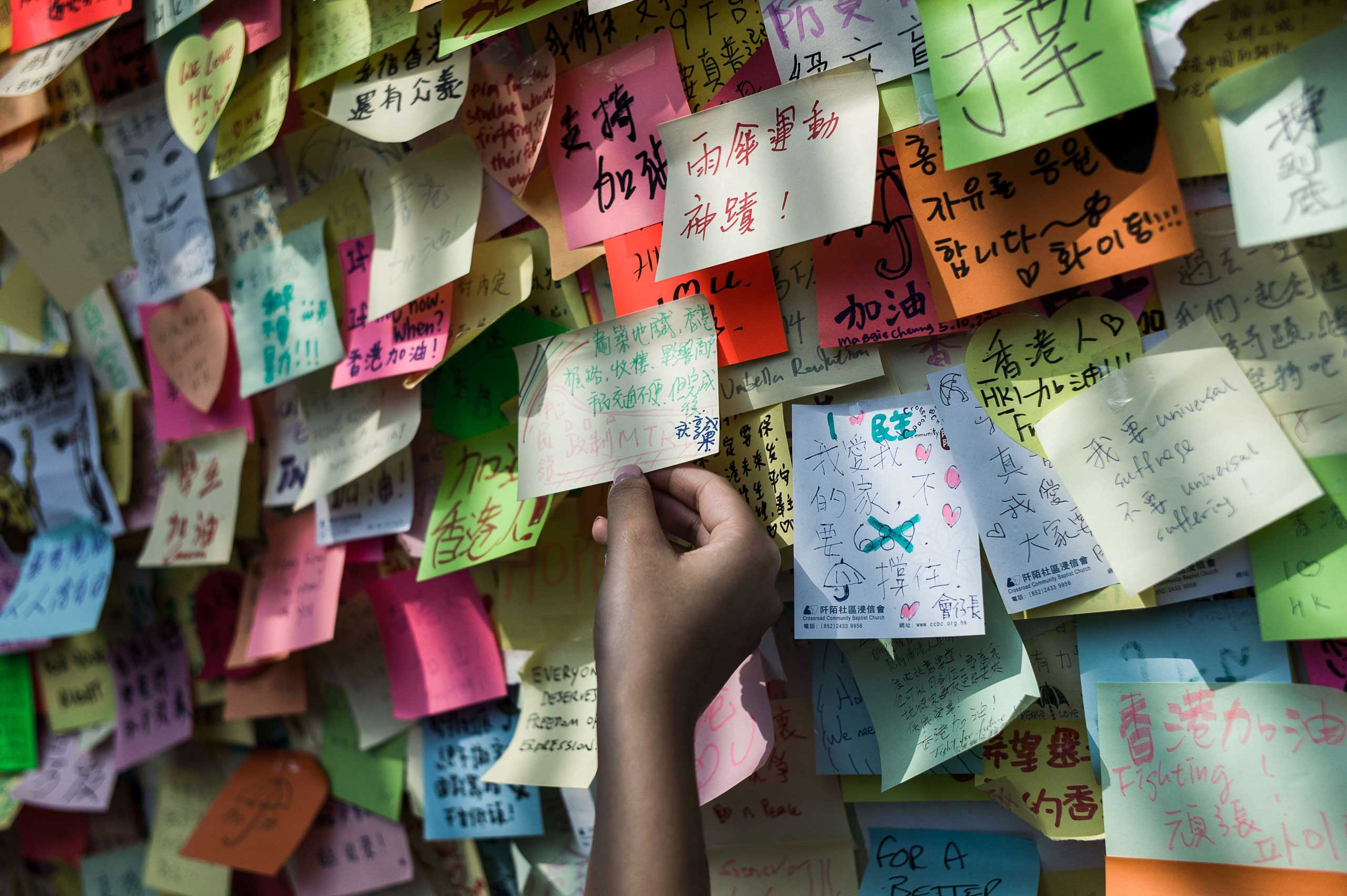 Oct. 7, 2014. A wall of post-it messages of support is seen near an occupied area in Hong Kong. Small knots of pro-democracy demonstrators remained on Hong Kong's streets after protest leaders agreed to talks with the government and dwindling demonstrator numbers dropped further.