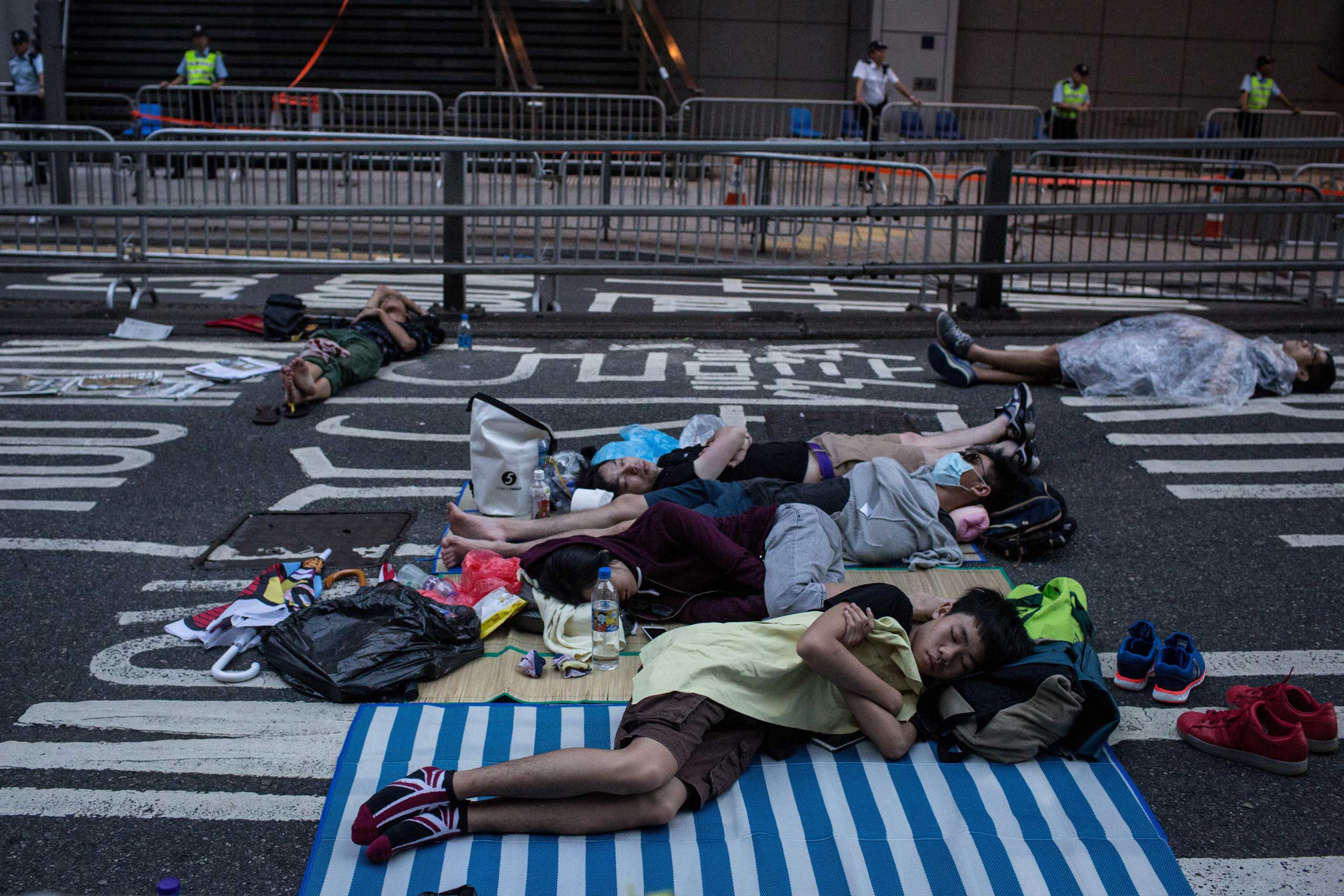 Protesters sleep on the road outside the Police Headquarters building on Oct. 2, 2014 in Hong Kong, Hong Kong.