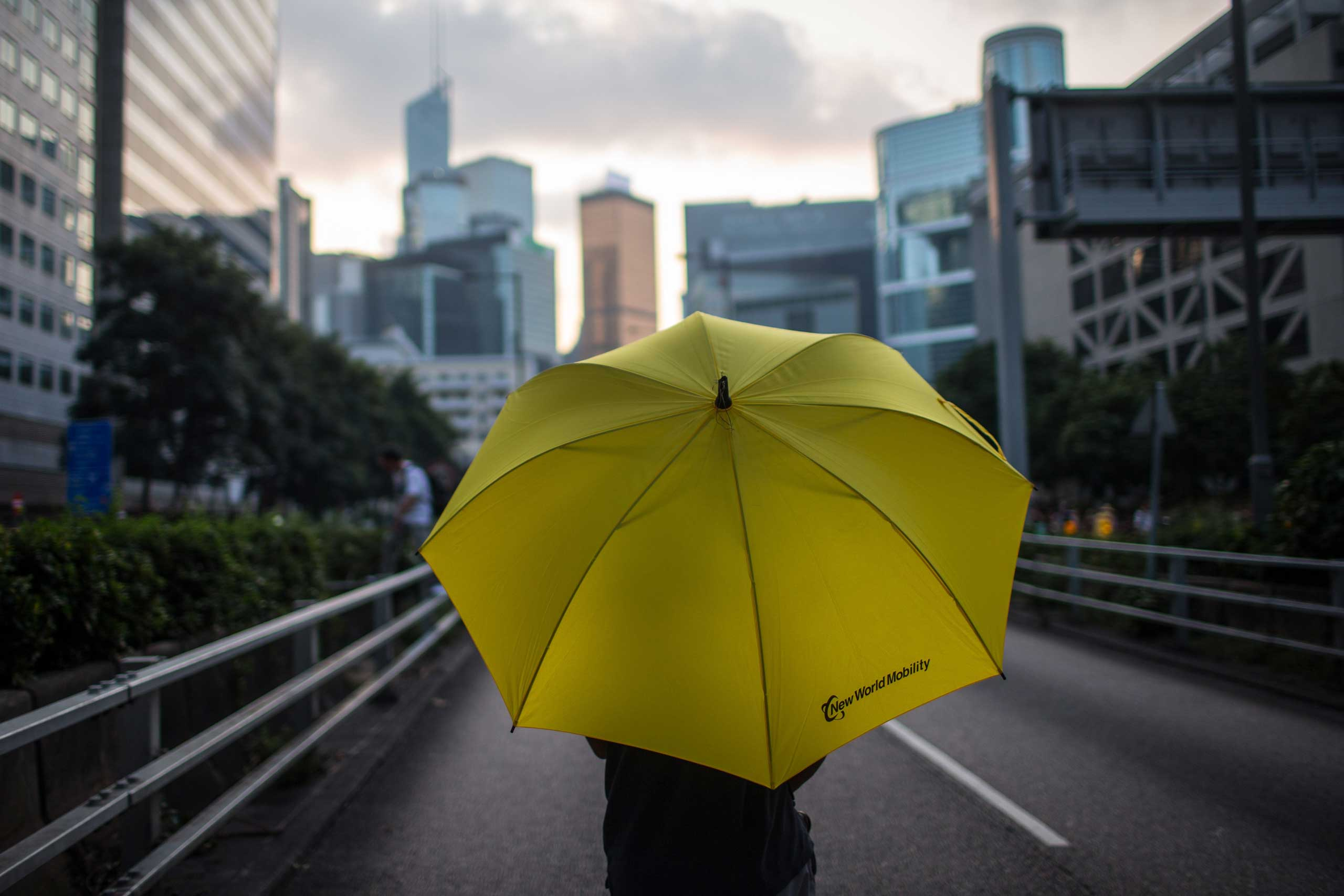 A protester holding an umbrella stands on the street close to the Hong Kong Government Complex on Oct. 1, 2014 in Hong Kong, Hong Kong.
