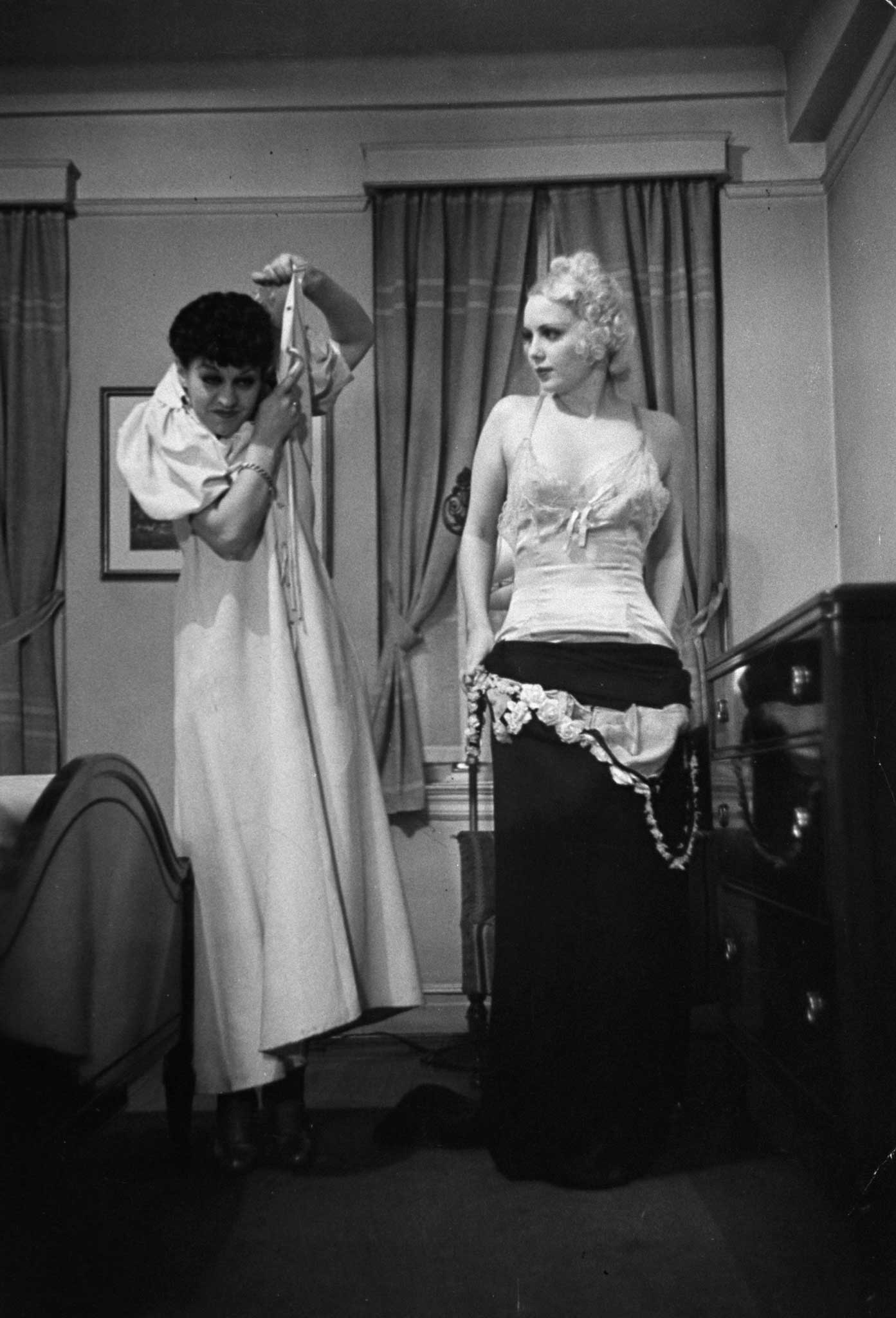 Burlesque star June St. Clair and Professor Connie Fonzlau demonstrate the right and wrong ways to disrobe at the Allen Gilbert School of Undressing in New York, 1937.