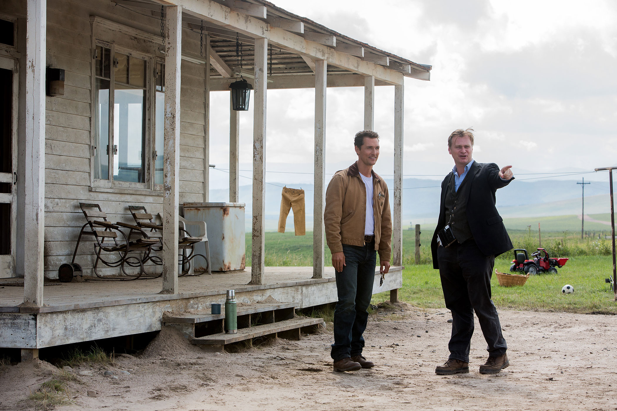 Matthew McConaughey discusses a scene with Director Christopher Nolan on the set of <i>Interstellar</i>.