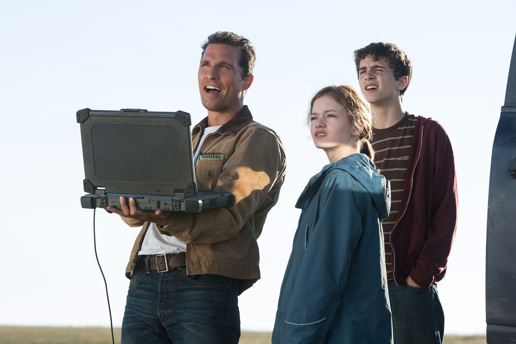 Matthew McConaughey, Mackenzie Foy, and Timothée Chalamet on the set of <i>Interstellar</i>.