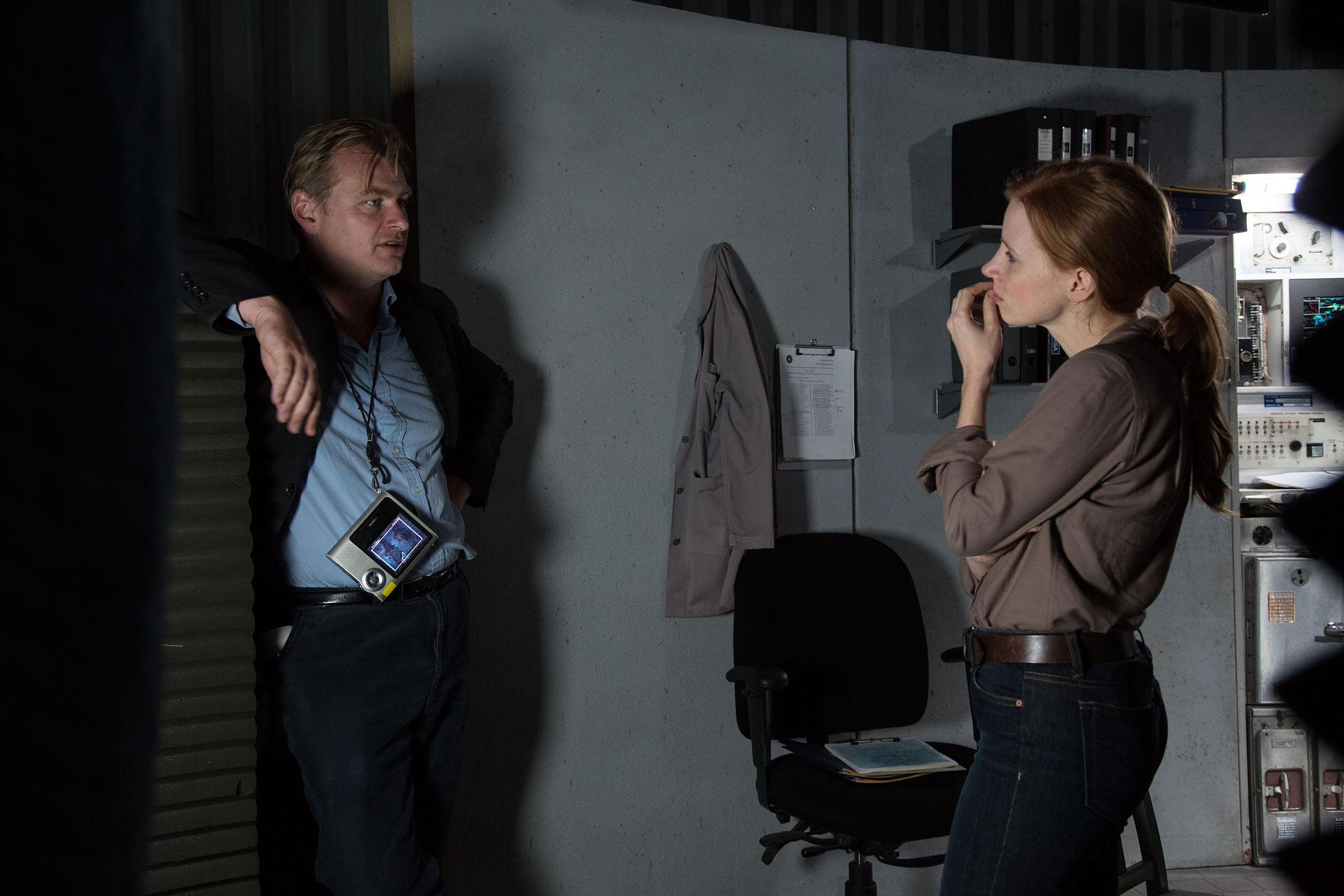 Director Christopher Nolan discusses a scene with Jessica Chastain on the set of <i>Interstellar</i>.
