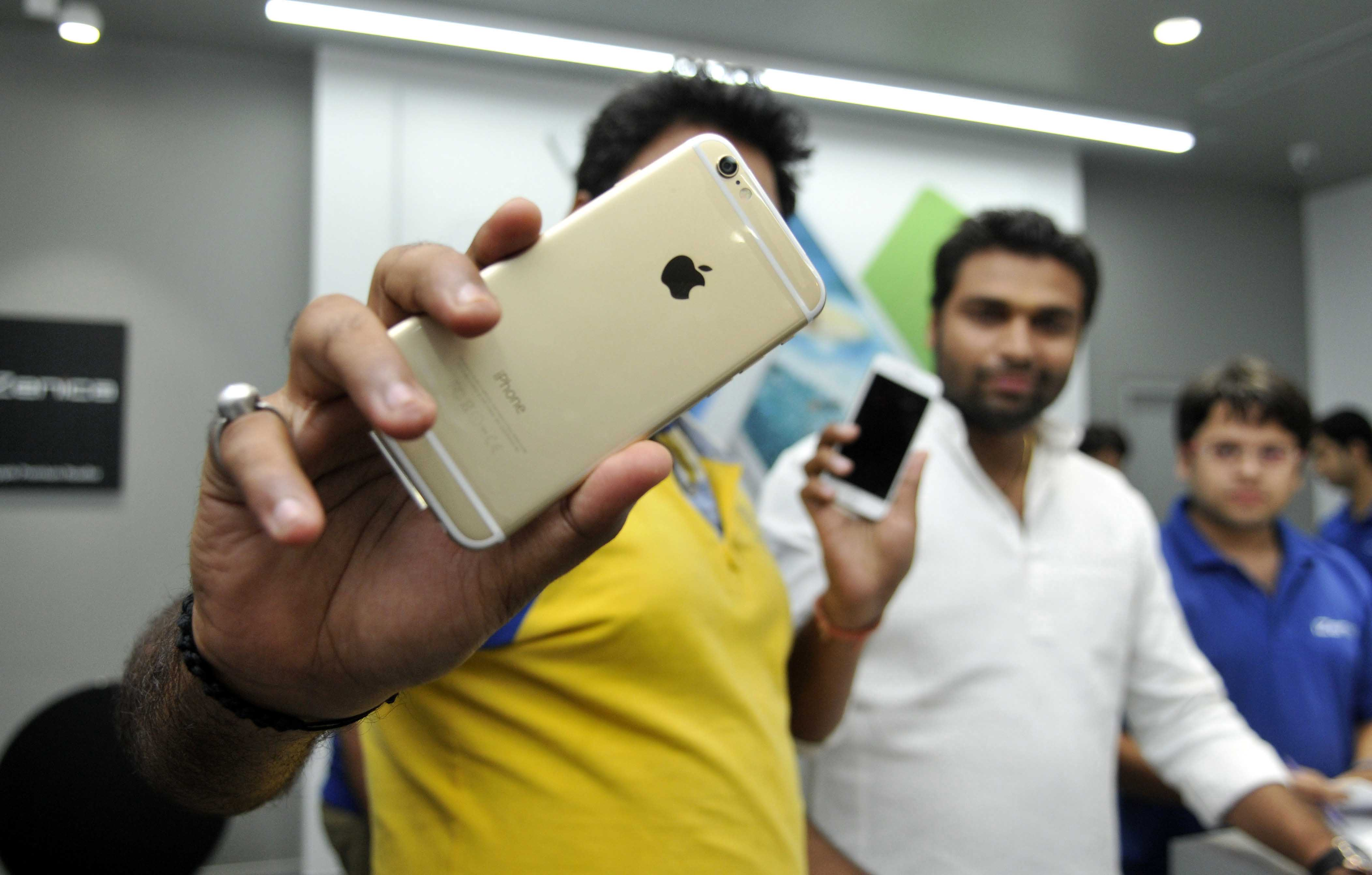 Excited crowd flocked at The Great India Palace mall to buy newly launched Apple iPhone 6 and iPhone 6 Plus, on October 17, 2014 in Noida, India.