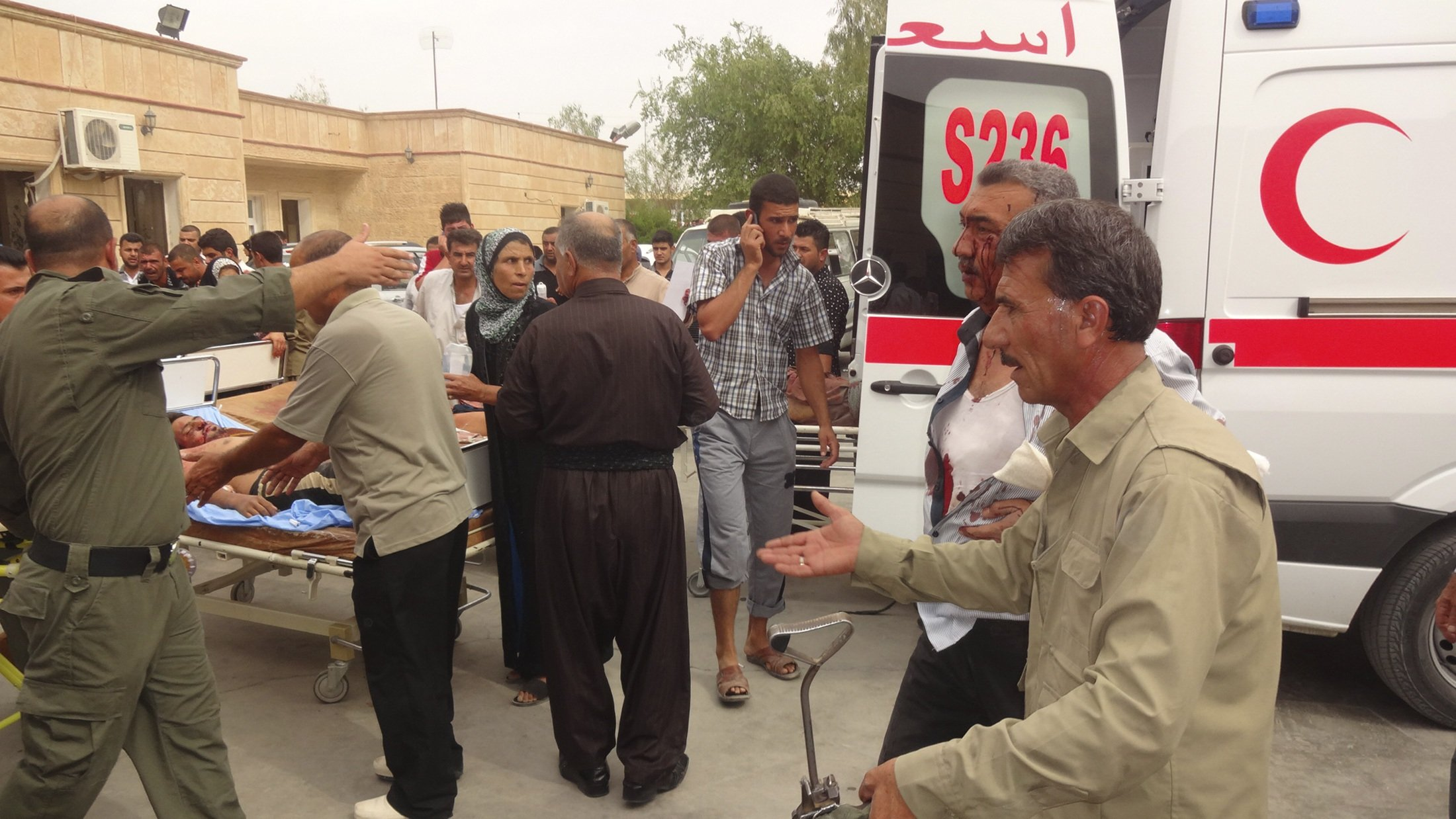 Men wounded by a car bomb in Qara Qubah are transported to a hospital in Kifri, Iraq on Oct. 12, 2014.