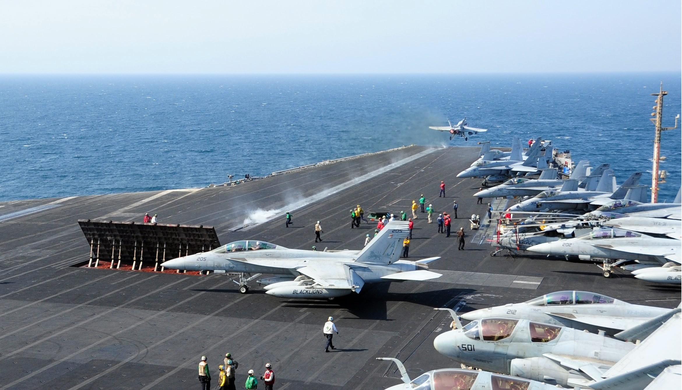 US Department of Defense (DOD) shows an aircraft launching from the flight deck of the aircraft carrier USS George H.W. Bush in the Arabian Gulf on Oct. 13, 2014.
