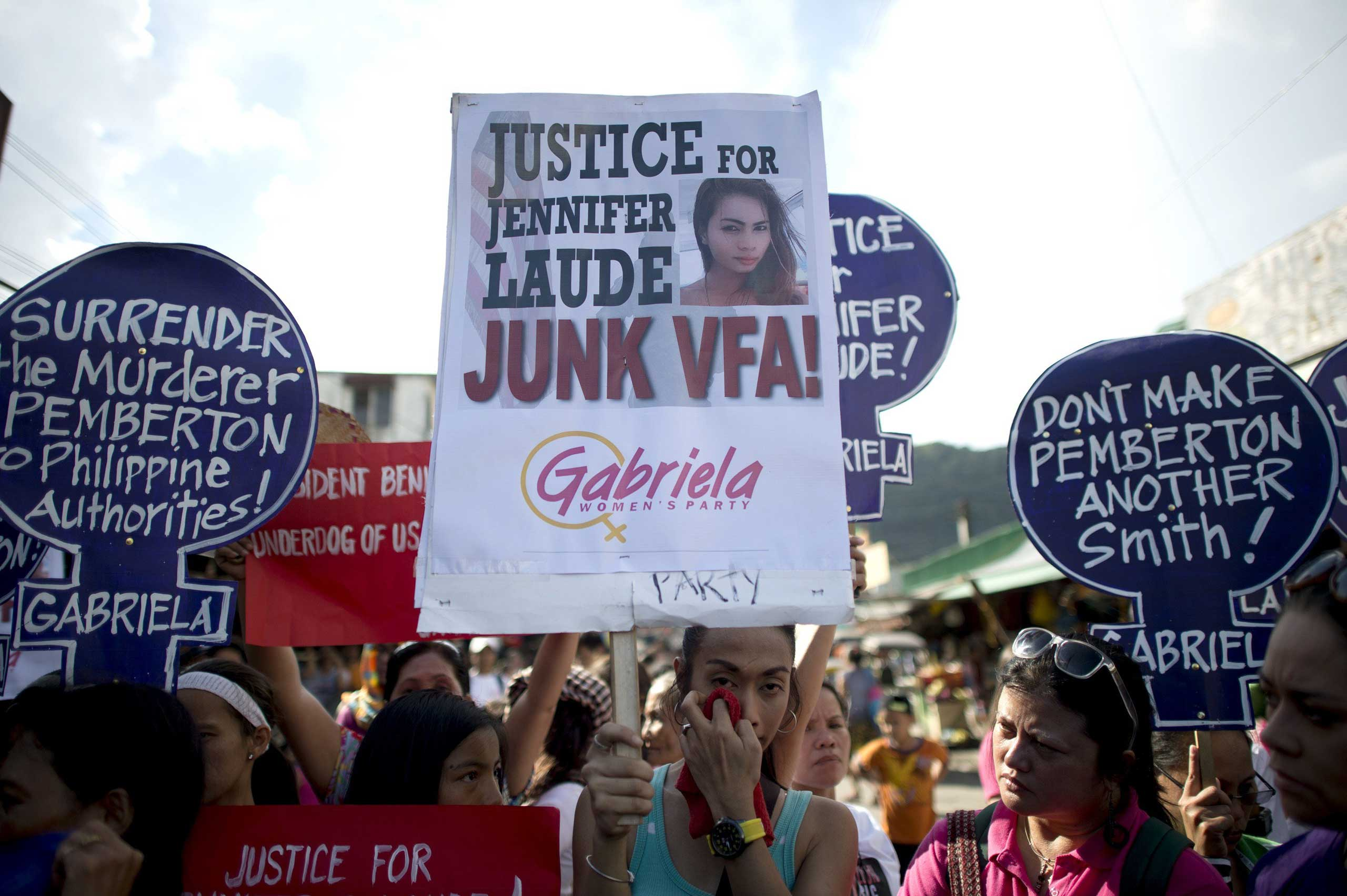 Supporters of murdered Filipino transgender Jeffrey Laude, also known as  Jennifer , hold a protest near the Hall of Justice where the preliminary hearing for the murder case is being held at the northern Philippine city of Olongapo on Oct. 10, 2014.