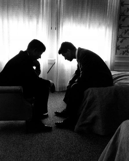 Senator and presidential candidate John F. Kennedy (left) and his campaign manager, Robert Kennedy, confer in a hotel room during the Democratic National Convention, Los Angeles, July 1960.