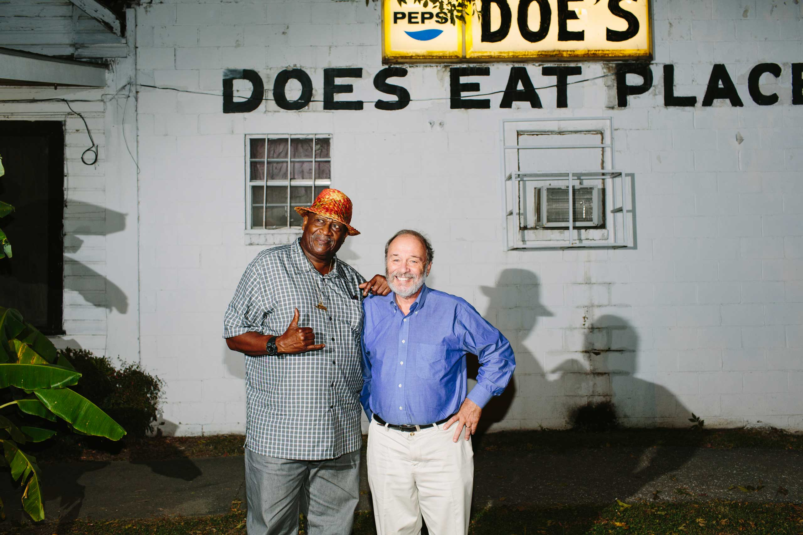 Musician Taj Mahal, left, and Joe Klein, right, at Doe's Eat Place in Greenville, Miss. on Sept. 30, 2014.