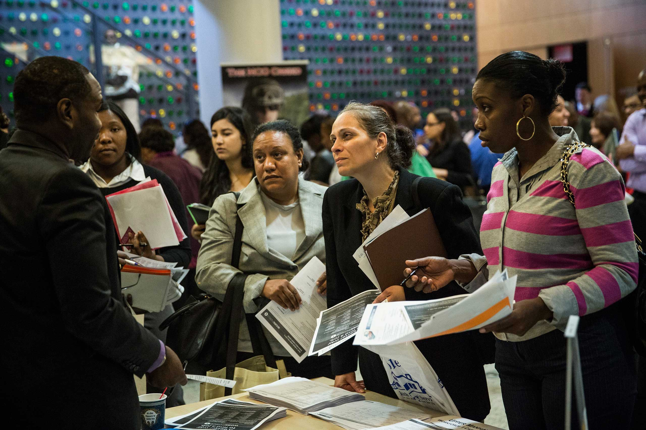 People attend a jobs fair at the Bronx Public Library on Sept. 17, 2014 in the Bronx Borough of New York City.