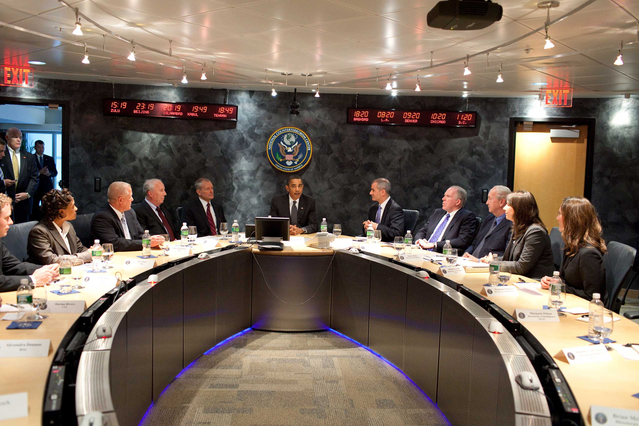 President Barack Obama meets with NCTC Director Michael Leiter, center right, leadership and analysts in the Secure Video Teleconference Room at the National Counterterrorism Center in McLean, Va, on Oct. 6, 2009.