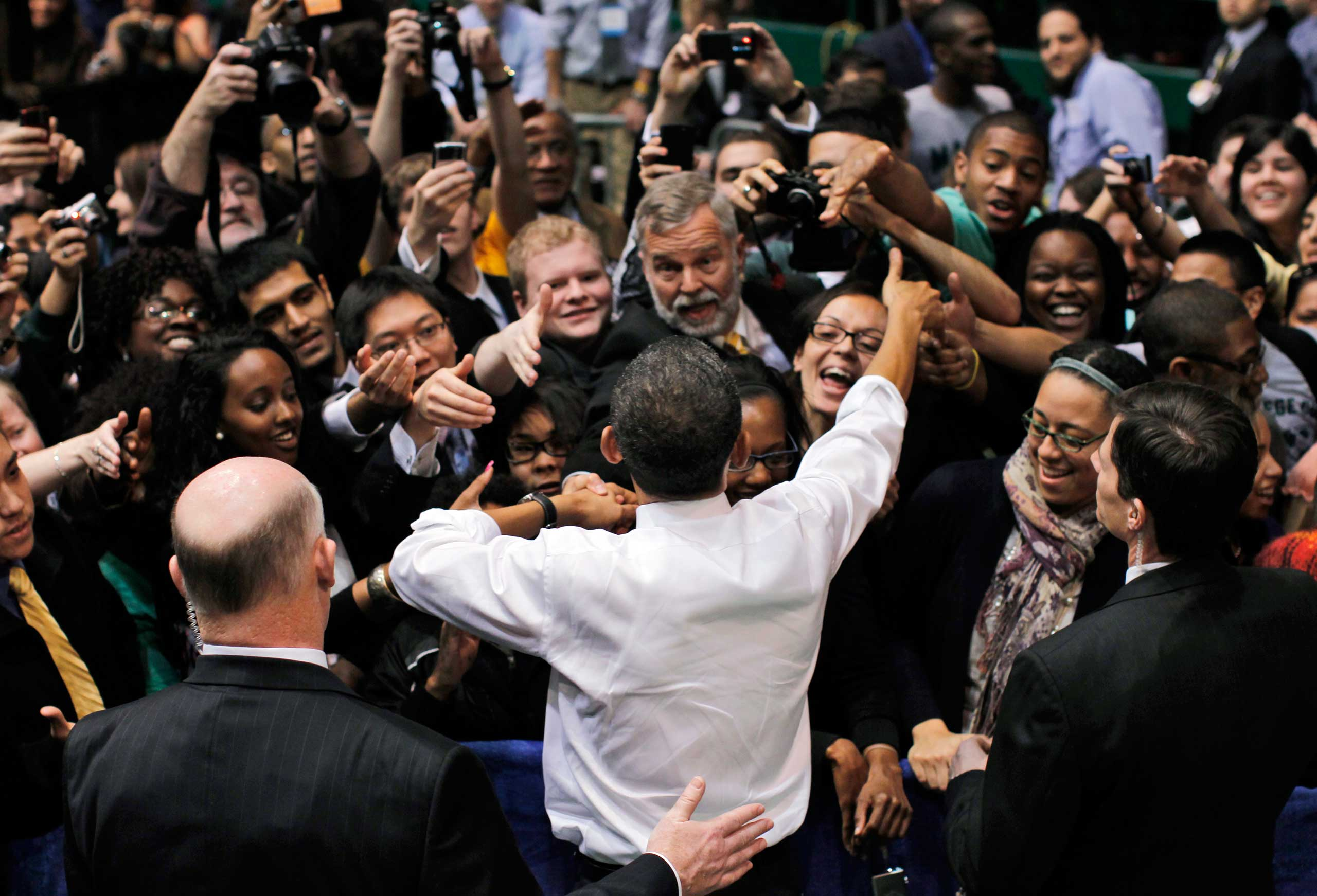 Clancy has President Barack Obama's back during a frenzied meet-and-greet with the audience after speaking about health care reform at the Patriot Center at George Mason University in Fairfax, Va. on March 19, 2010.
