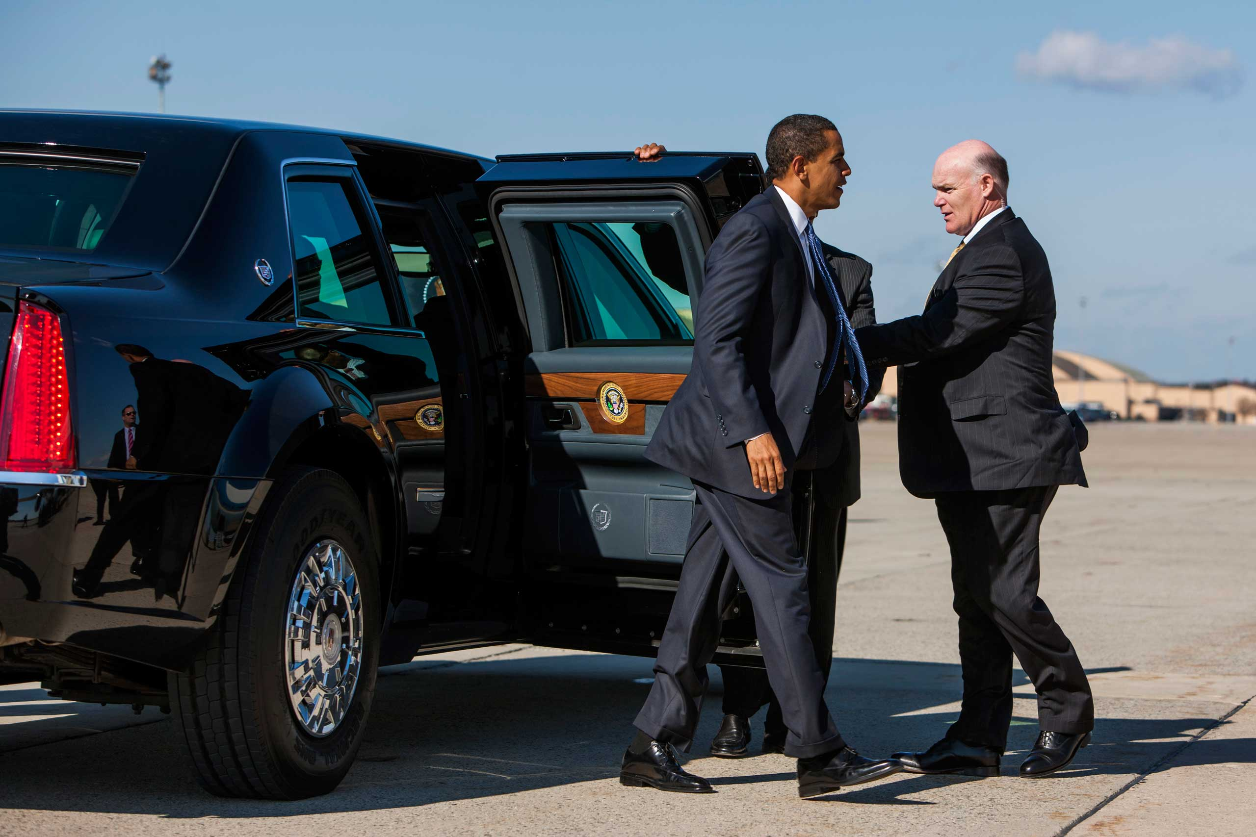 Clancy holds the door for Barack Obama as the President departs Andrews Air Force Base in Md. on Feb. 12, 2009.