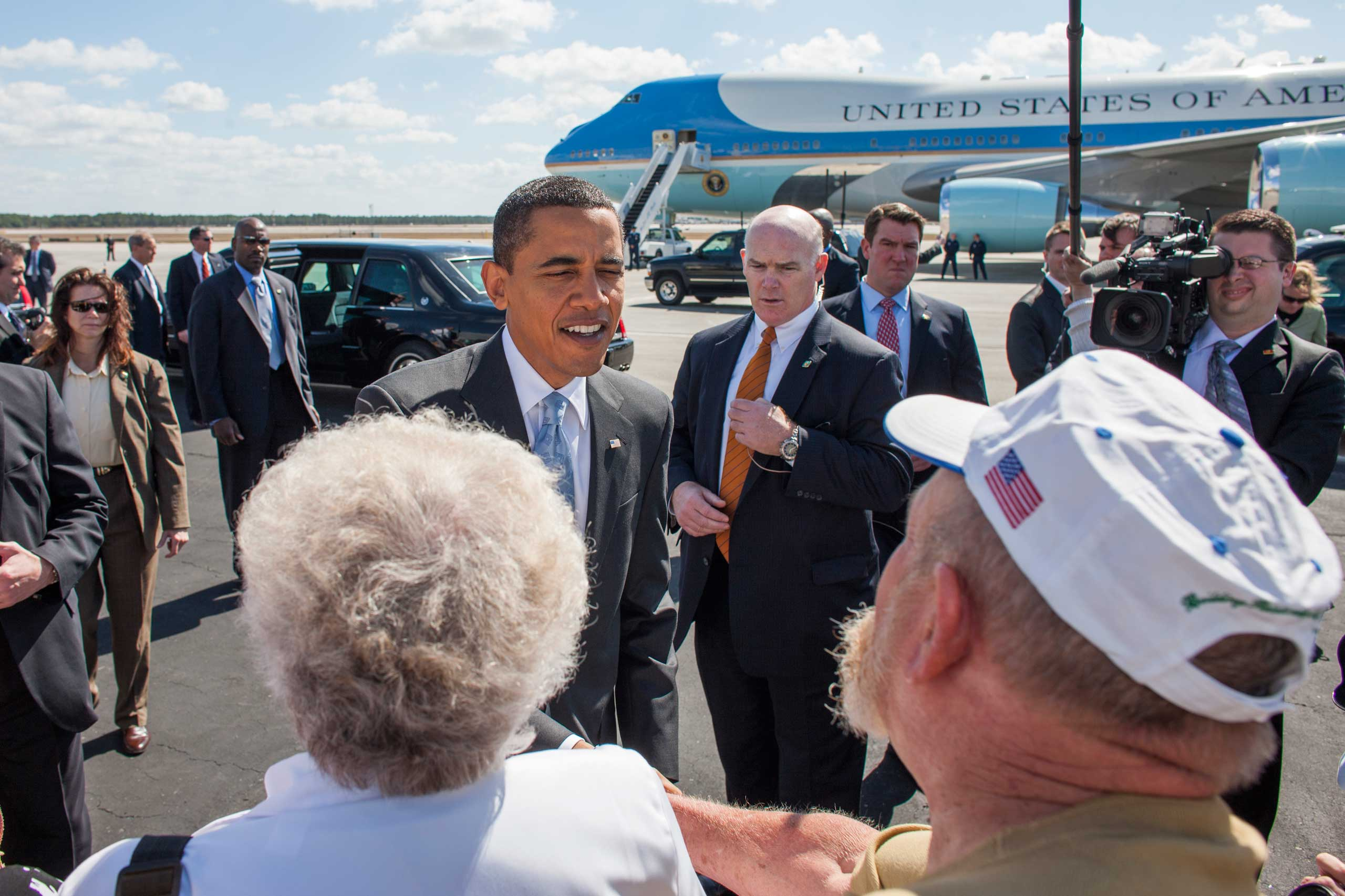 President Barack Obama greets supporters at the Fort Meyers airport in Florida, as Clancy stands watch behind the President's left shoulder, Feb. 10, 2009.